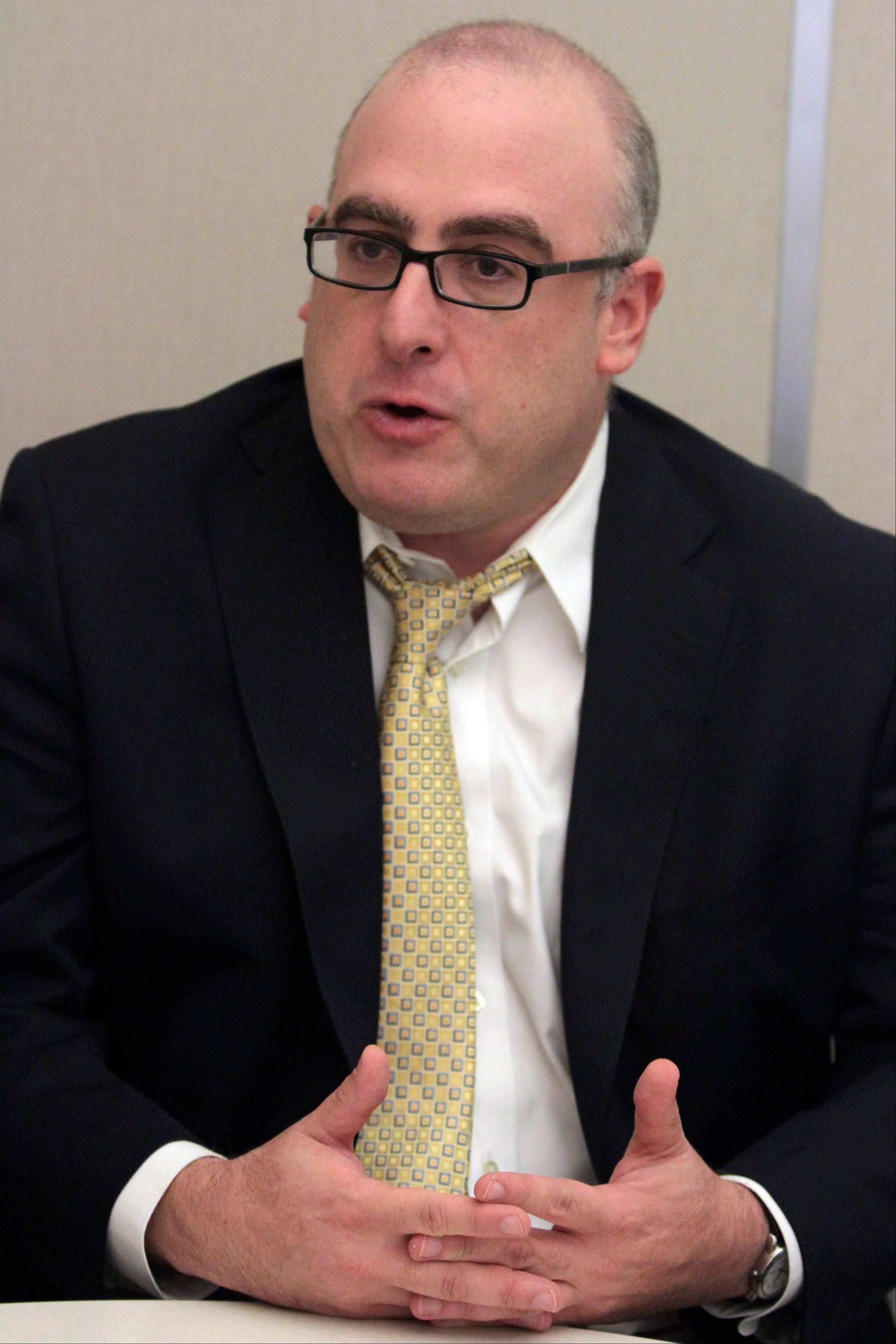 "Joe Posnanski author of ""Paterno"" gestures during an interview with the Associated Press, Tuesday, Aug. 21 2012, in New York."