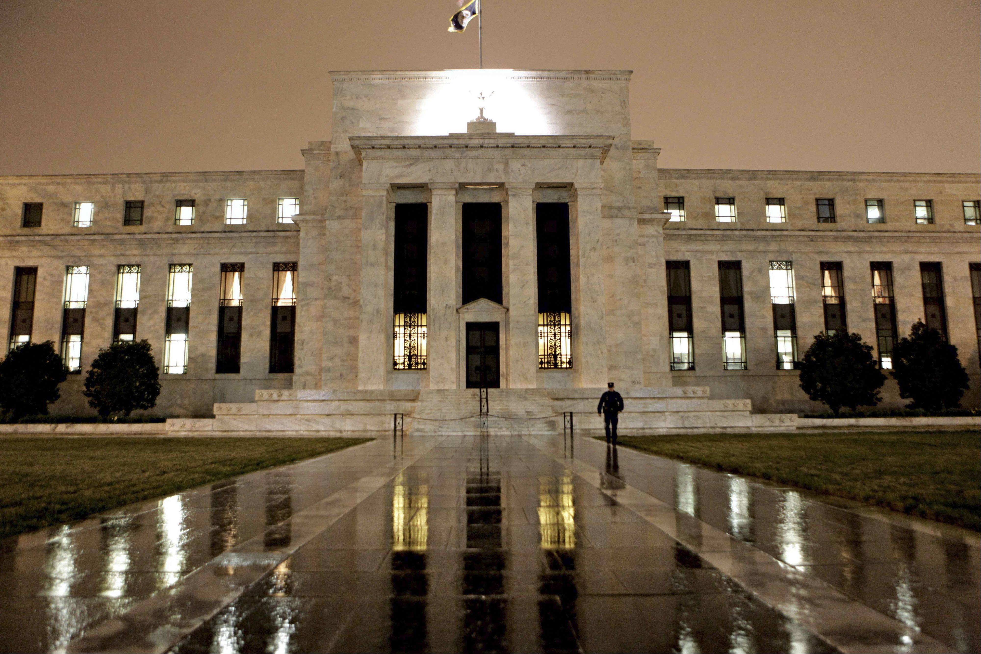 Fed minutes released Wednesday show many officials favored pushing the timetable for any increase in record-low short-term rates beyond the Fed's current plan of at least late 2014.