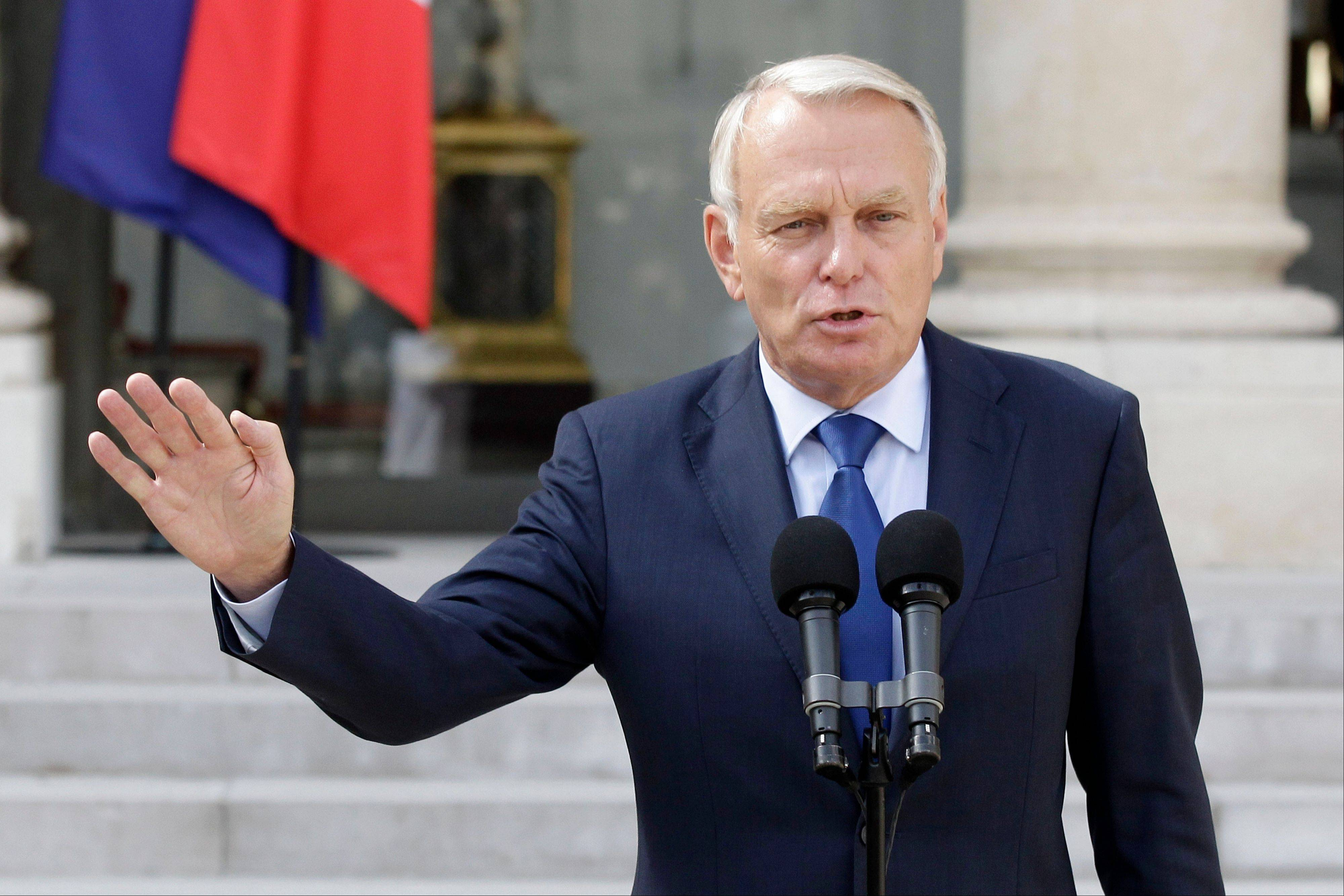 France's Prime Minister Jean-Marc Ayrault says his government will lower taxes on gasoline to ease the pinch of rising prices on French pocketbooks.