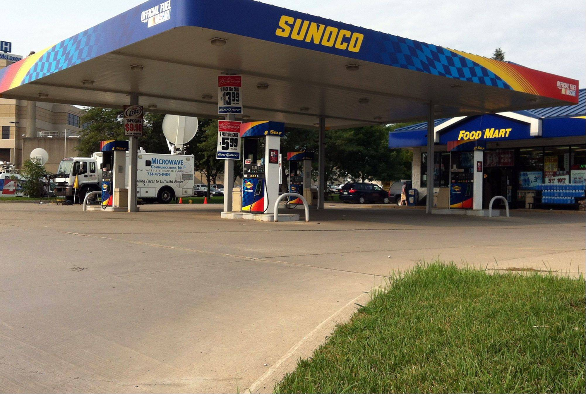 Gas prices are advertised at a Sunoco gas station and market in Lapeer, Mich.