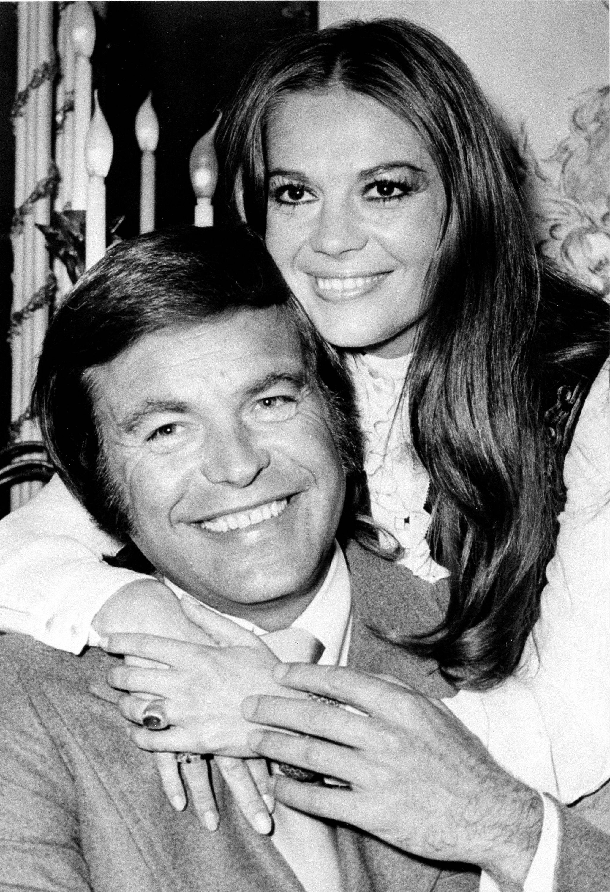 Actor Robert Wagner and his former wife, actress Natalie Wood, pose in a 1972 photo. Authorities have amended Wood's death certificate to reflect some of the lingering questions about how the actress died in the waters off Catalina Island in 1981.