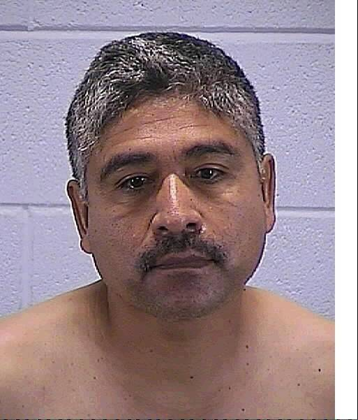 Camilo Rivera of Aurora is accused of beating his wife with a hammer early Wednesday morning, causing massive head injuries.