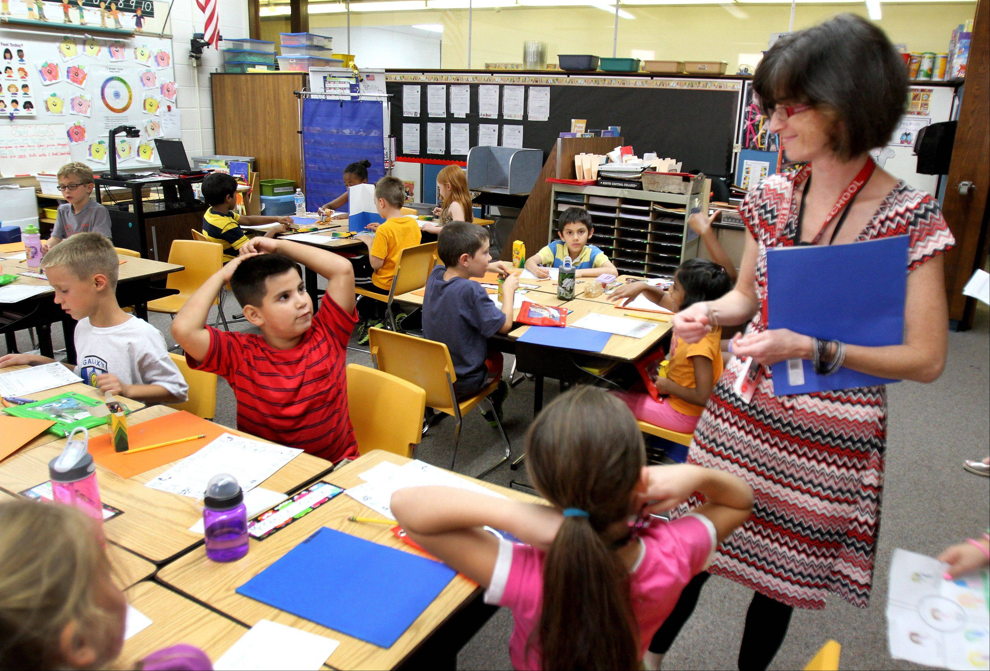 Second-grade teacher Jane Reich has about 12 fewer students in her Mill Street School classroom this fall thanks to boundary changes implemented by Naperville Unit District 203.