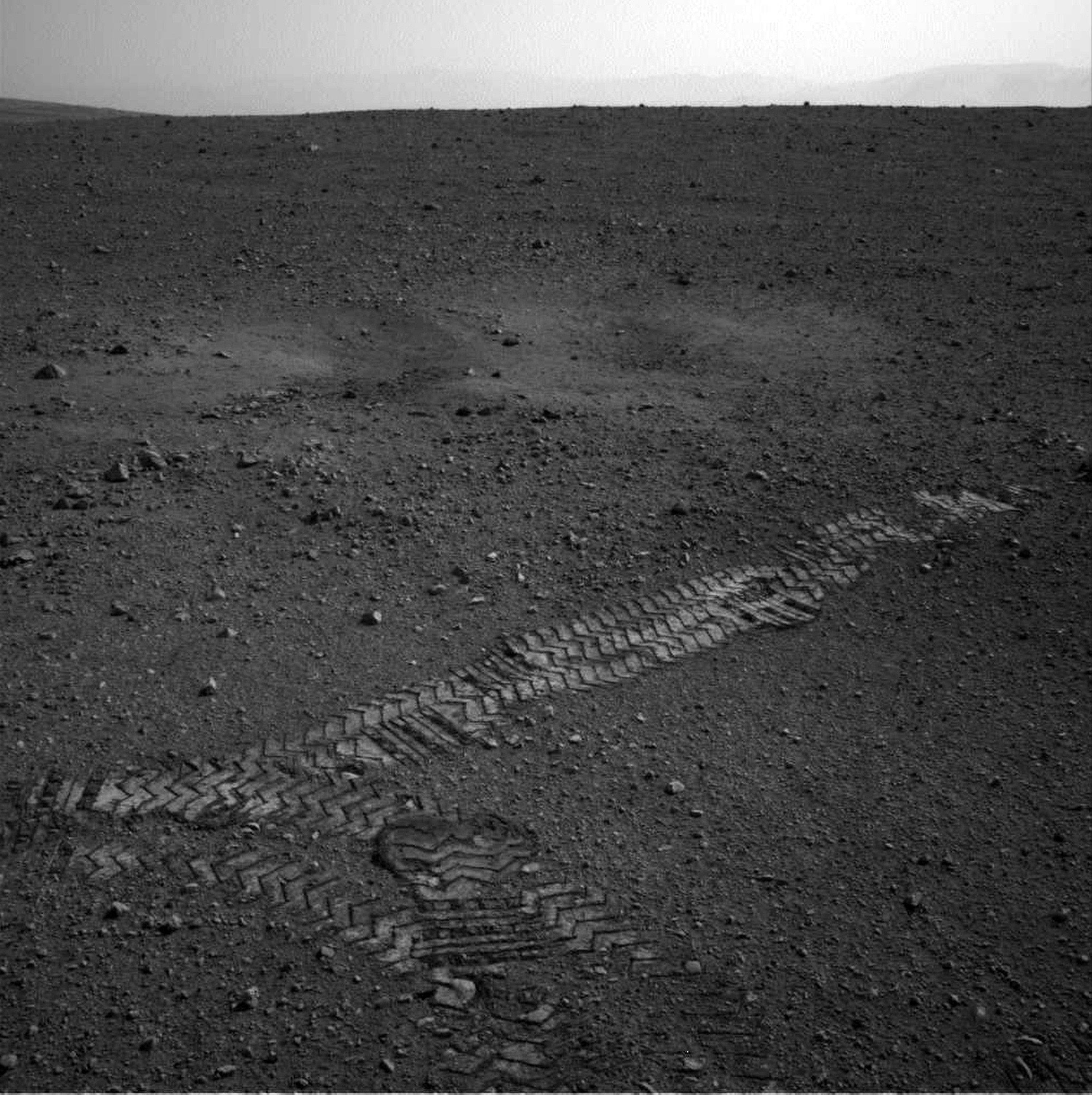 This image dated Wednesday and provided by NASA shows the Curiosity rover�s wheel tracks on the surface of Mars an image sent from one of the rover�s cameras.