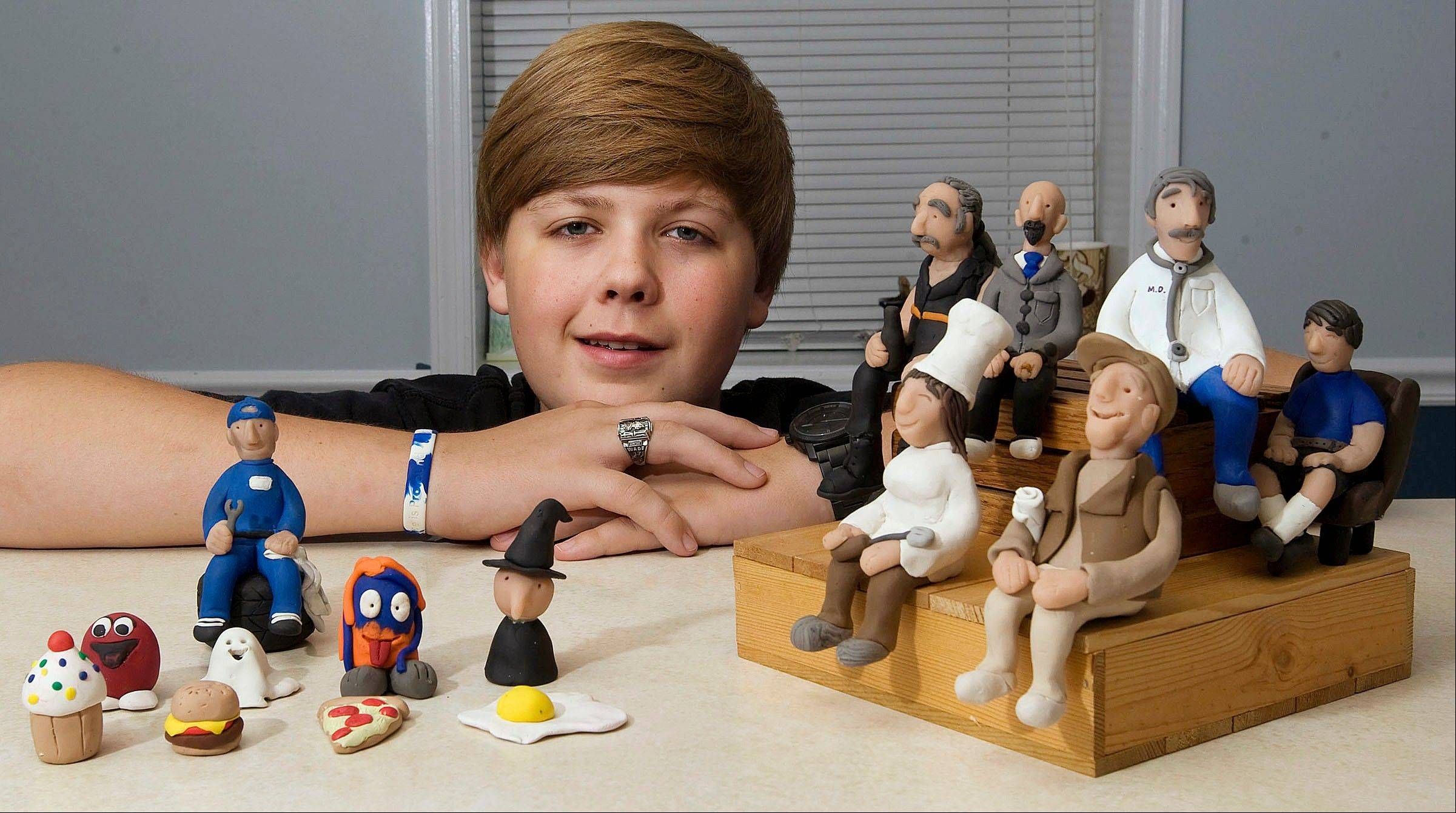 Young sculptor Wade Ripple, 15, of Mount Zion with clay figures he created.