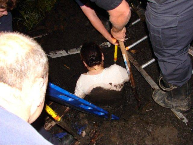 Rescue crews pull a 57-year-old Wauconda woman from mud late Monday night.