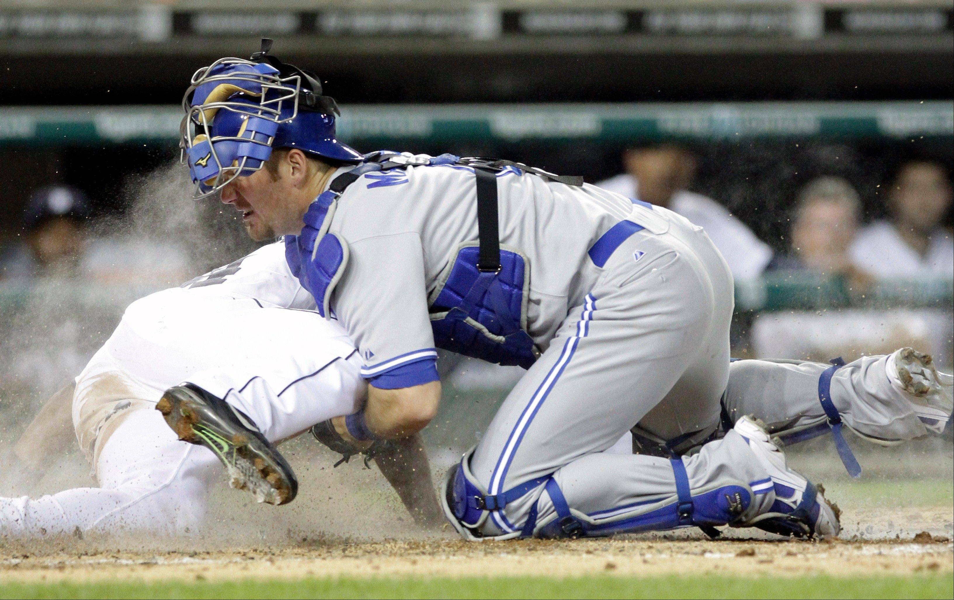 The Tigers' Austin Jackson, left, scores on a single by Prince Fielder as Toronto Blue Jays catcher Jeff Mathis loses the ball in the sixth inning Wednesday in Detroit.