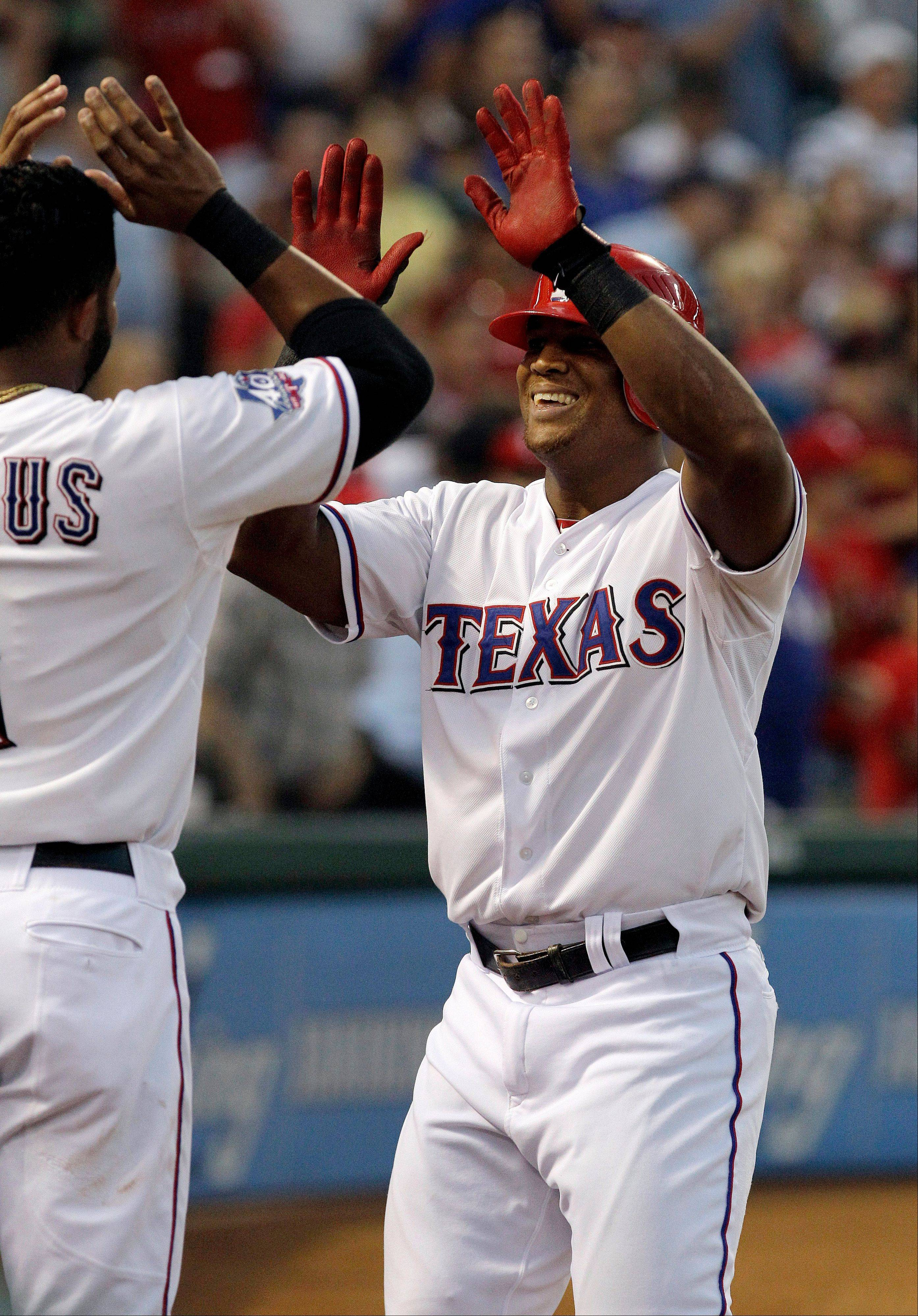 The Rangers' Adrian Beltre, right, celebrates with Elvis Andrus after Beltre's home run during the fourth inning Wednesday at home against Baltimore.