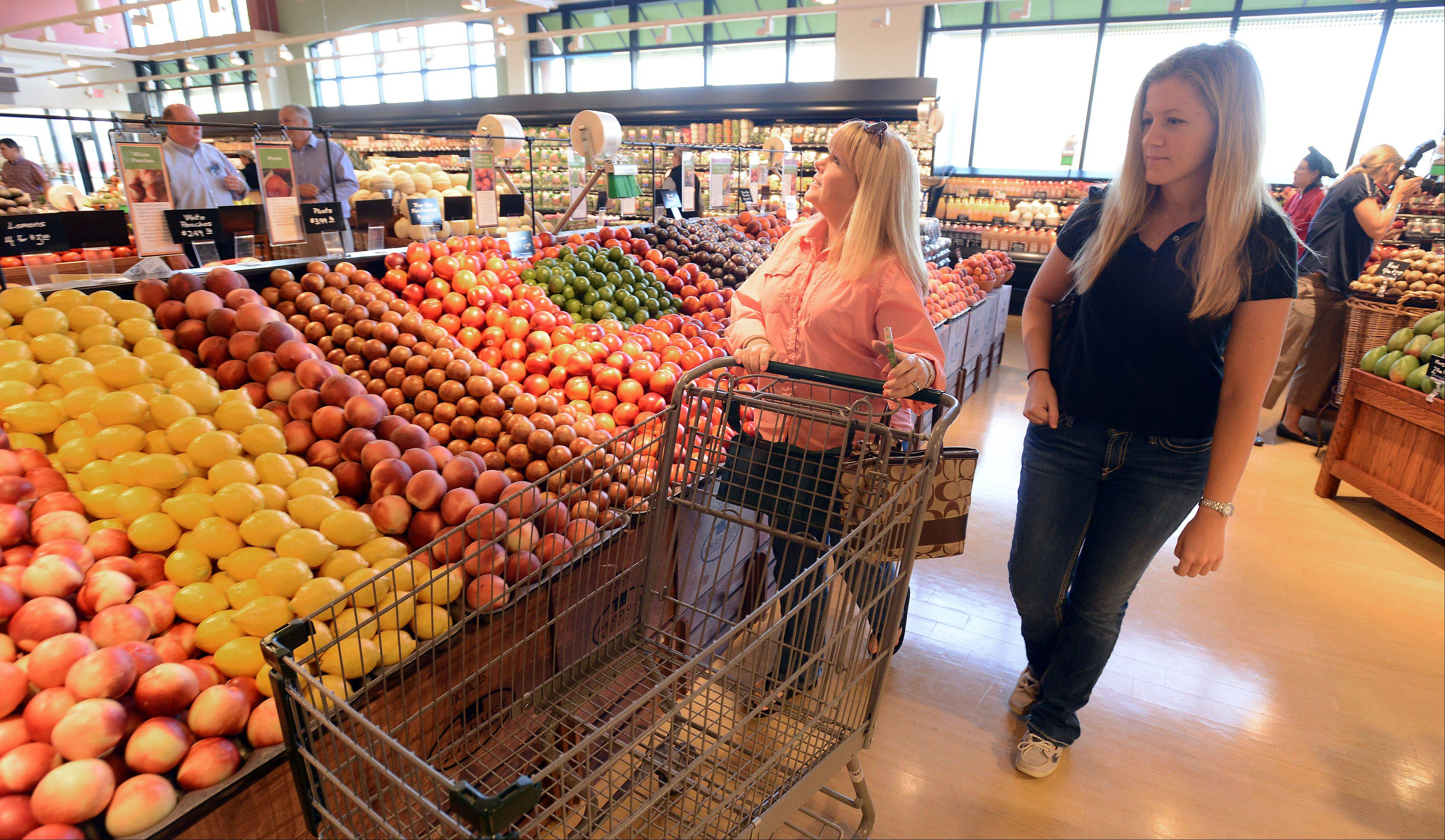 Nancy and Missy Apmann check out the new Heinen's Fine Foods store in Barrington, where they were the first shoppers Wednesday morning. The store is the Cleveland-based chain's first in the Chicago area.