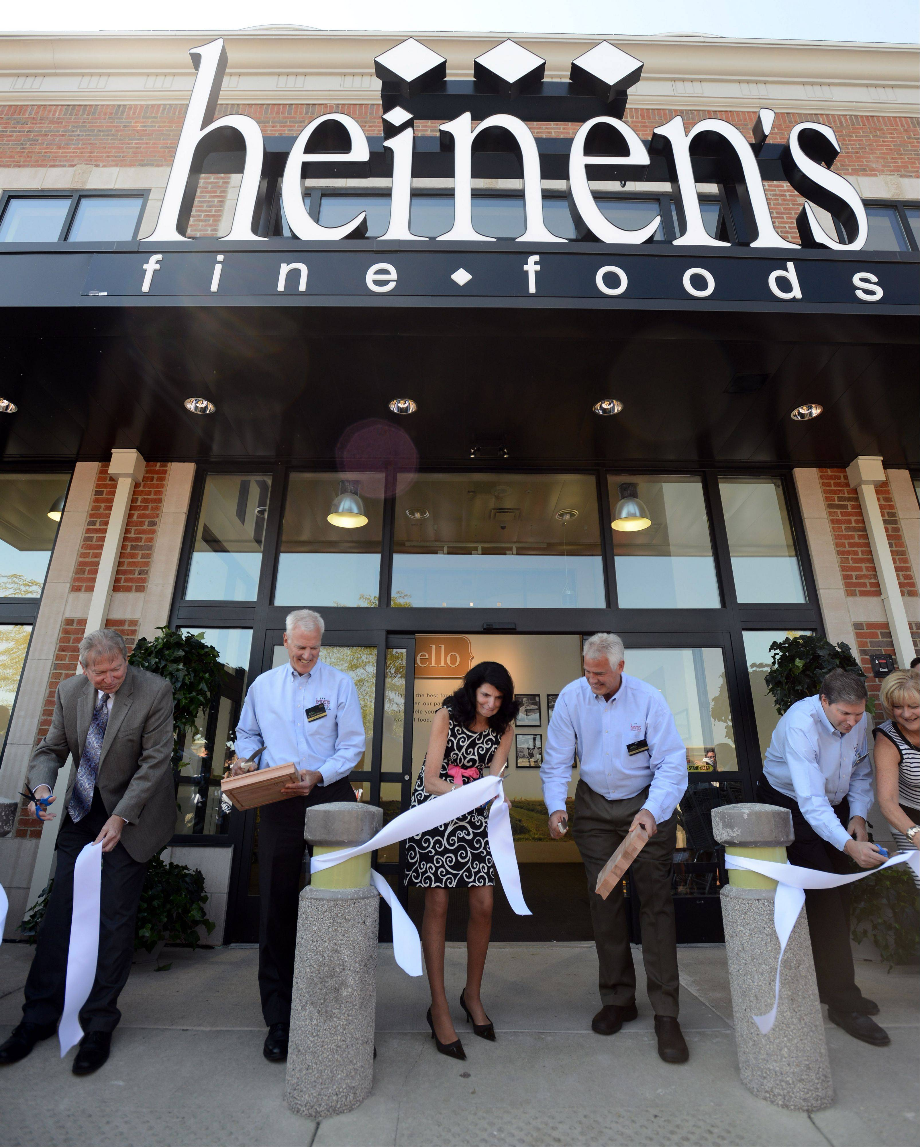 Co-owners and brothers Jeff and Tom Heinen along with Barrington Village President Karen Darch cut the ribbon at the grand opening of Heinen's Fine Foods in Barrington Wednesday morning. The store is the Cleveland-based chain's first in the Chicago area.