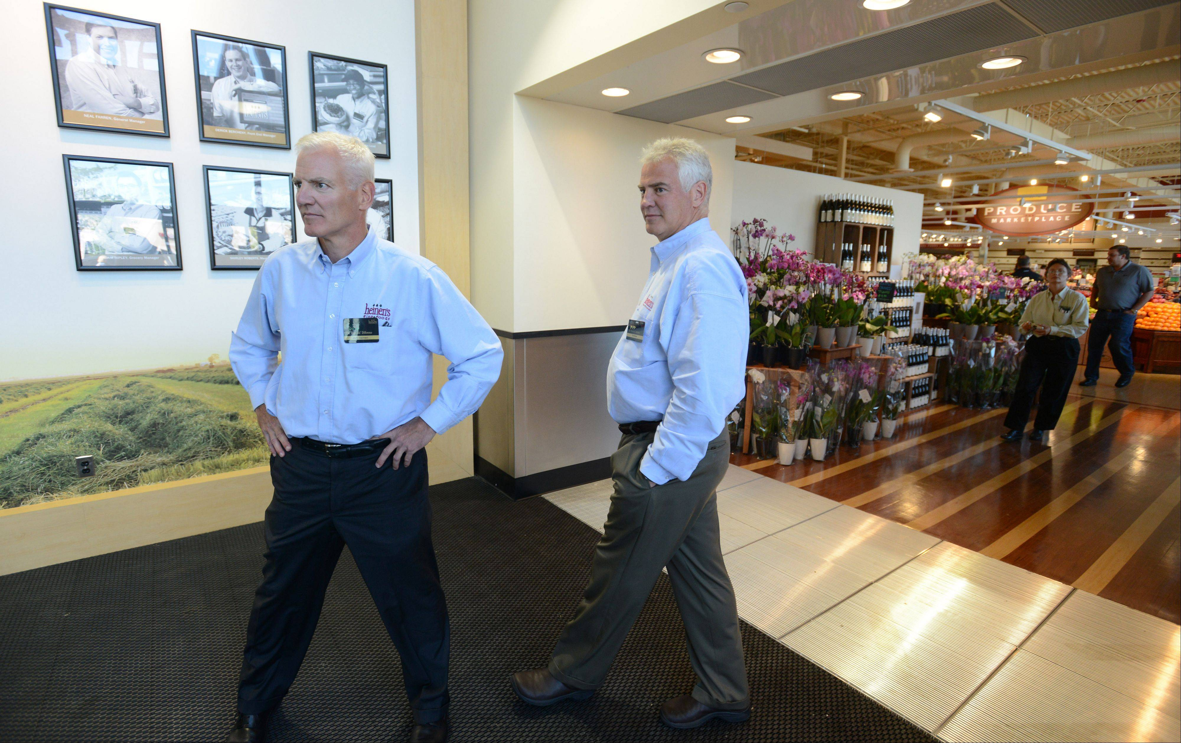 Brothers Jeff and Tom Heinen get ready to open the 18th location of Heinen's Fine Foods, their 83-year-old, family-owned grocery store chain, in Barrington Wednesday morning. The store is Heinen's first in the Chicago area.