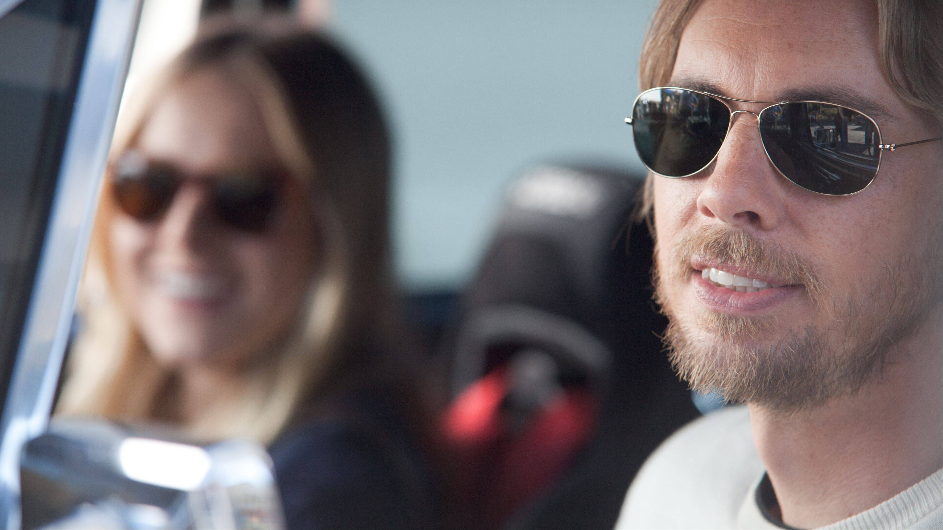 "Dax Shepard serves as the writer, co-director and star of the new road comedy ""Hit & Run,"" shown here with co-star Kristen Bell, his real-life main squeeze."