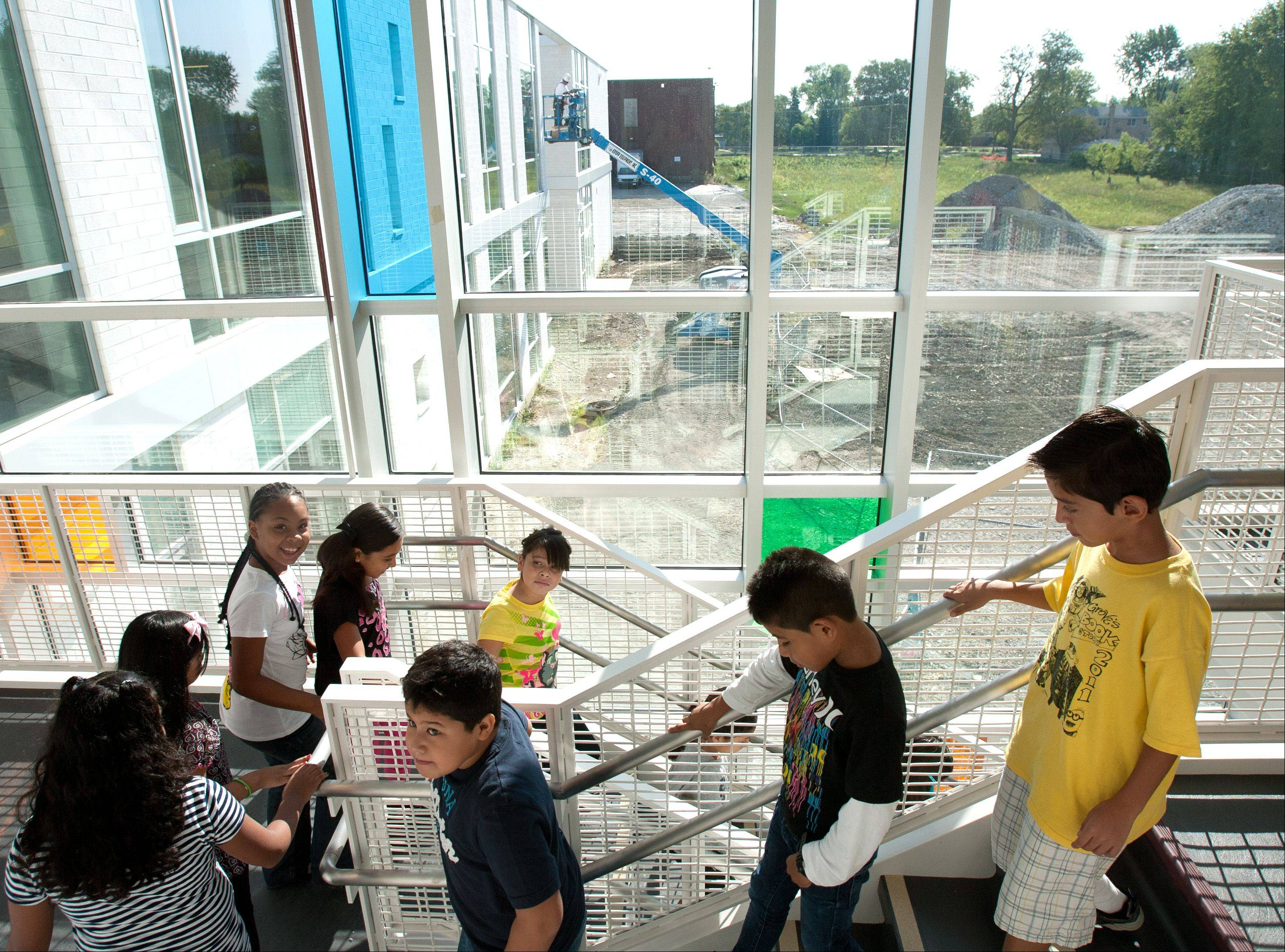 Tioga School students make their way to an assembly inside their new gym during on the first day of school.