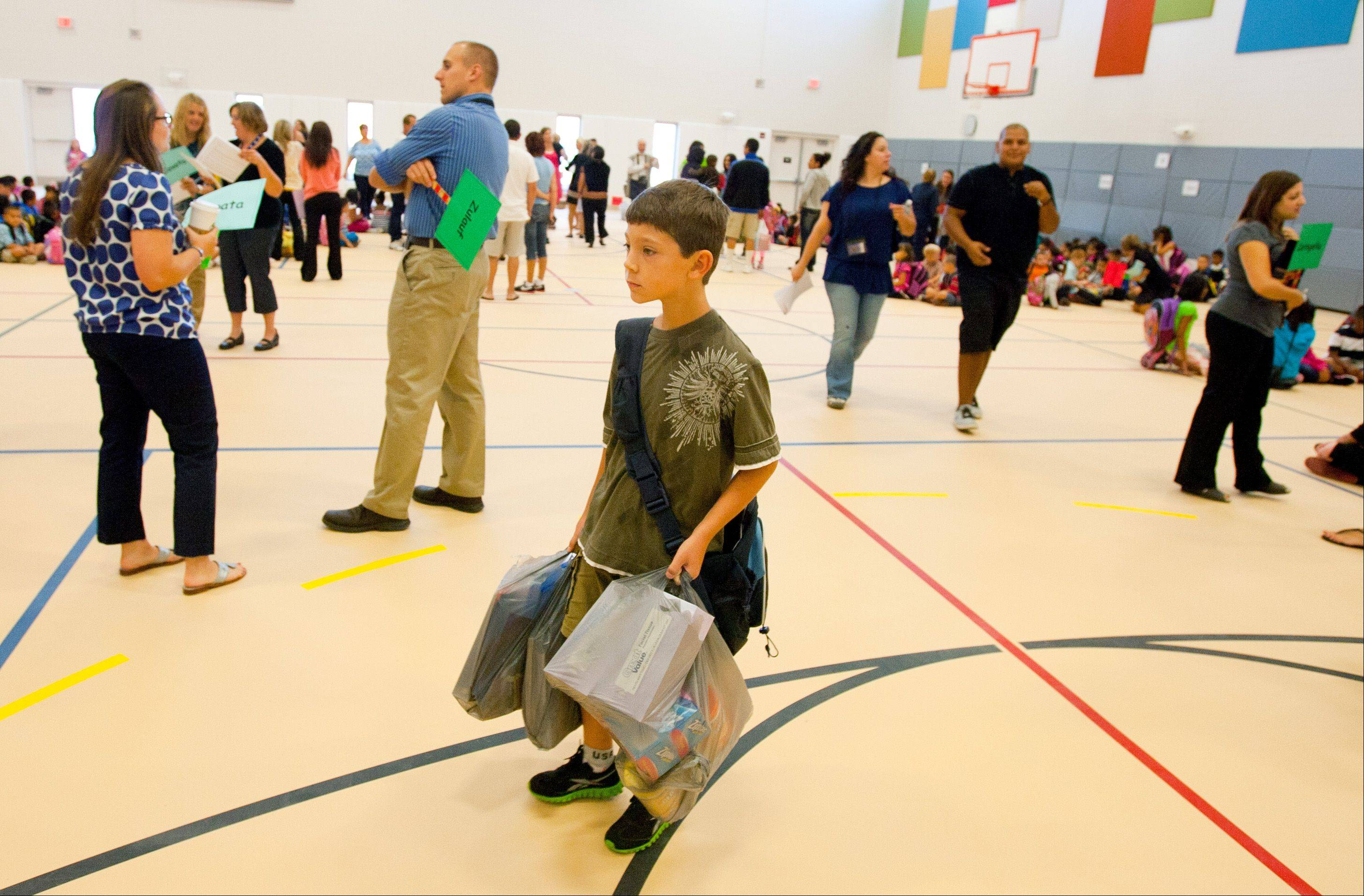 Alan Lazar eyes his fourth-grade classmates Wednesday inside the new, $21.8 million addition at Tioga School in Bensenville during the first day of school.