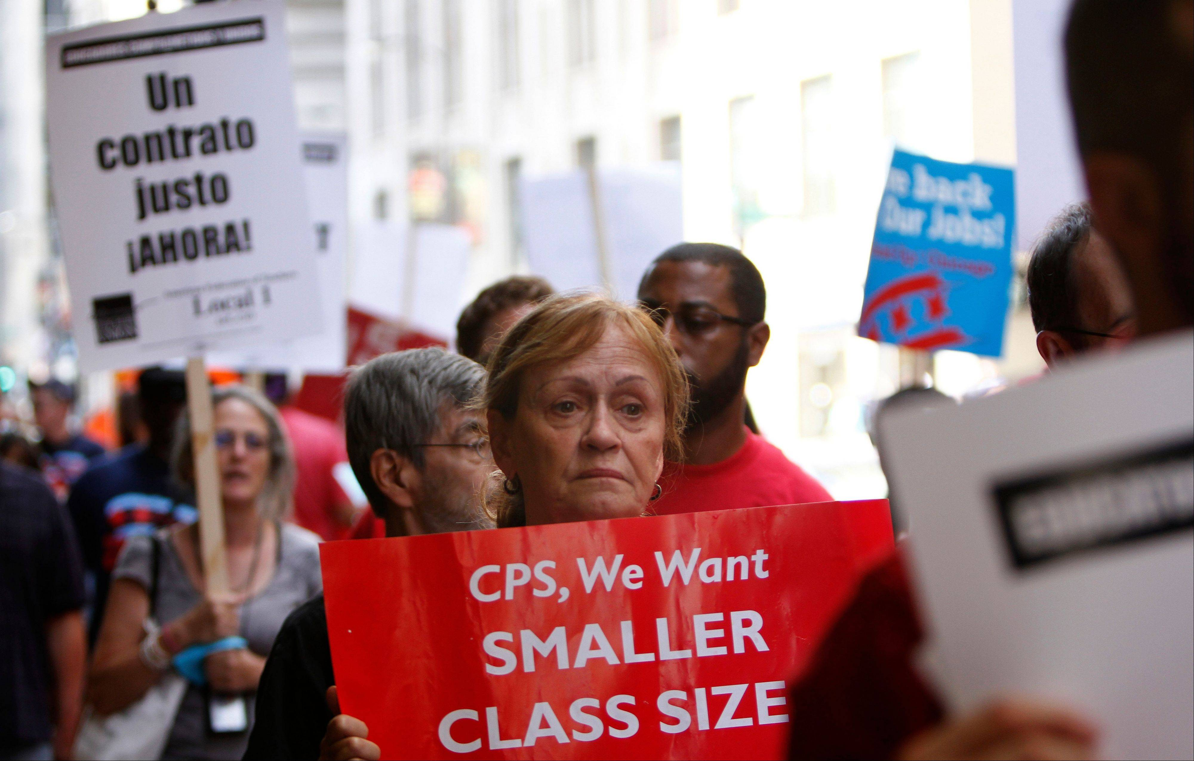 Chicago Teachers Union members picket before a Chicago Board of Education meeting on Wednesday in Chicago.