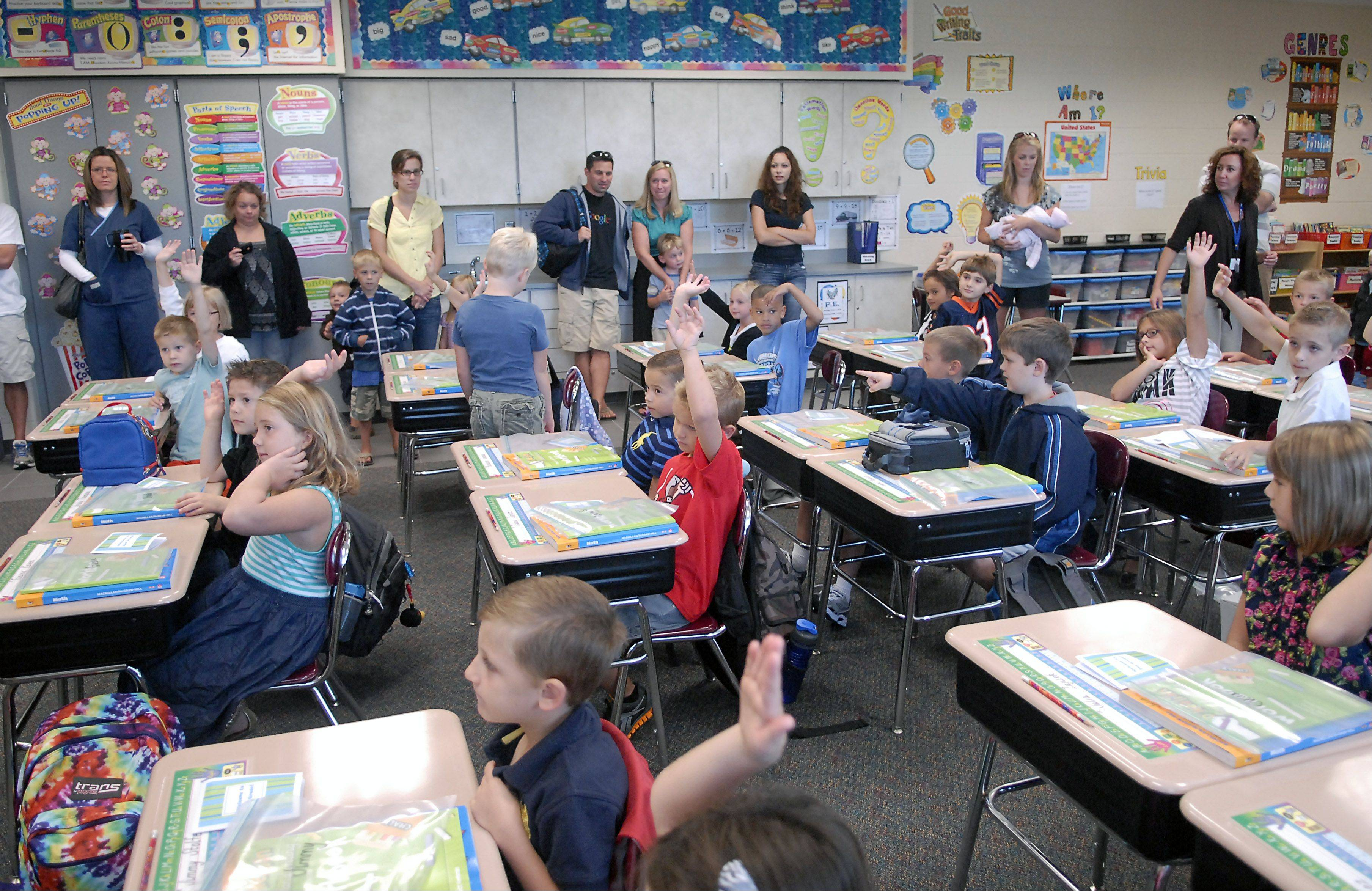 Parents are allowed to observe the first ten minutes of class in Tina Huffman's second-grade class on the first day of school at Williamsburg Elementary School.