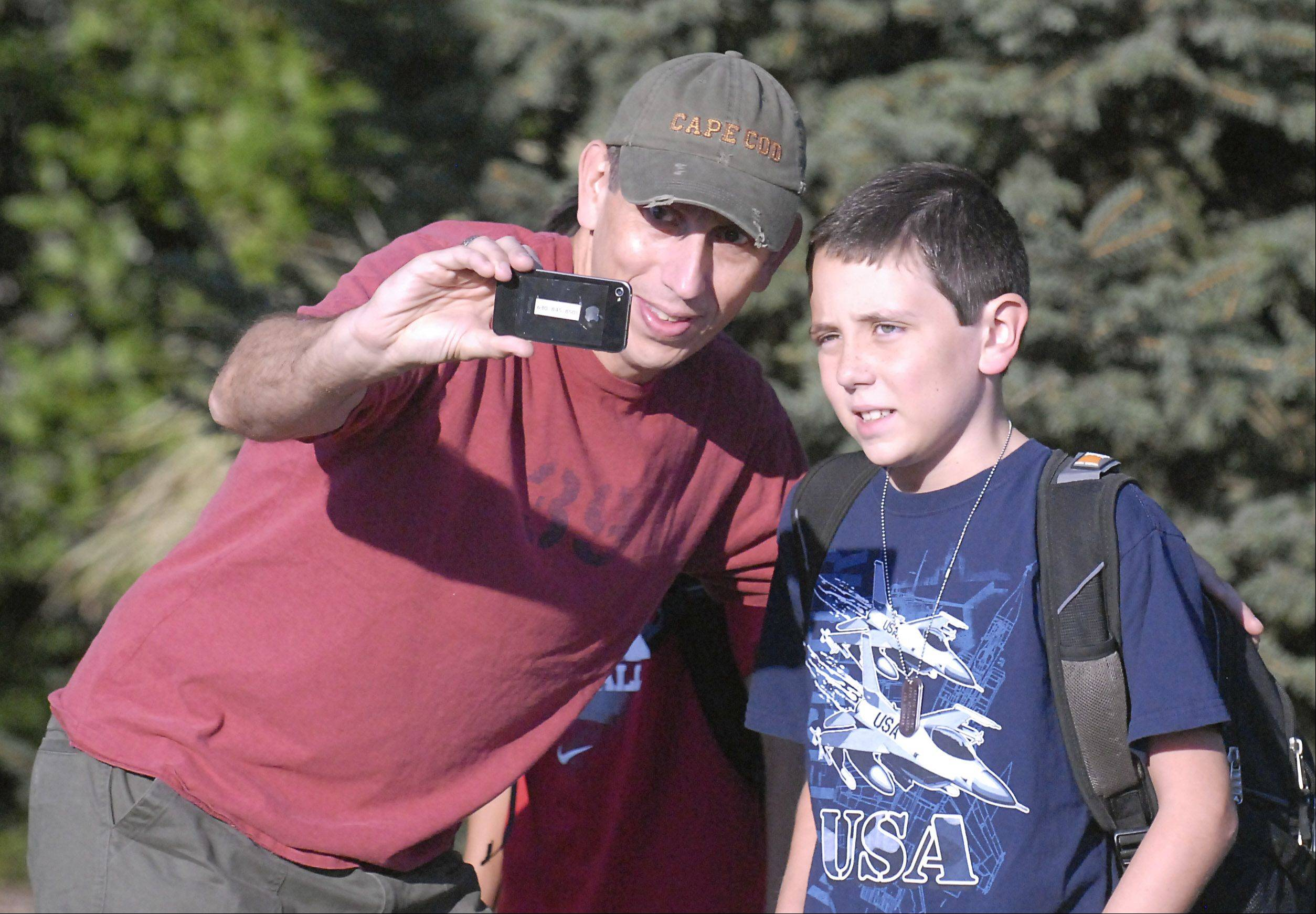 Doug Rodgers takes a photo of himself and his son, Tom, 9, before the start of fourth grade at Williamsburg Elementary School in Geneva.