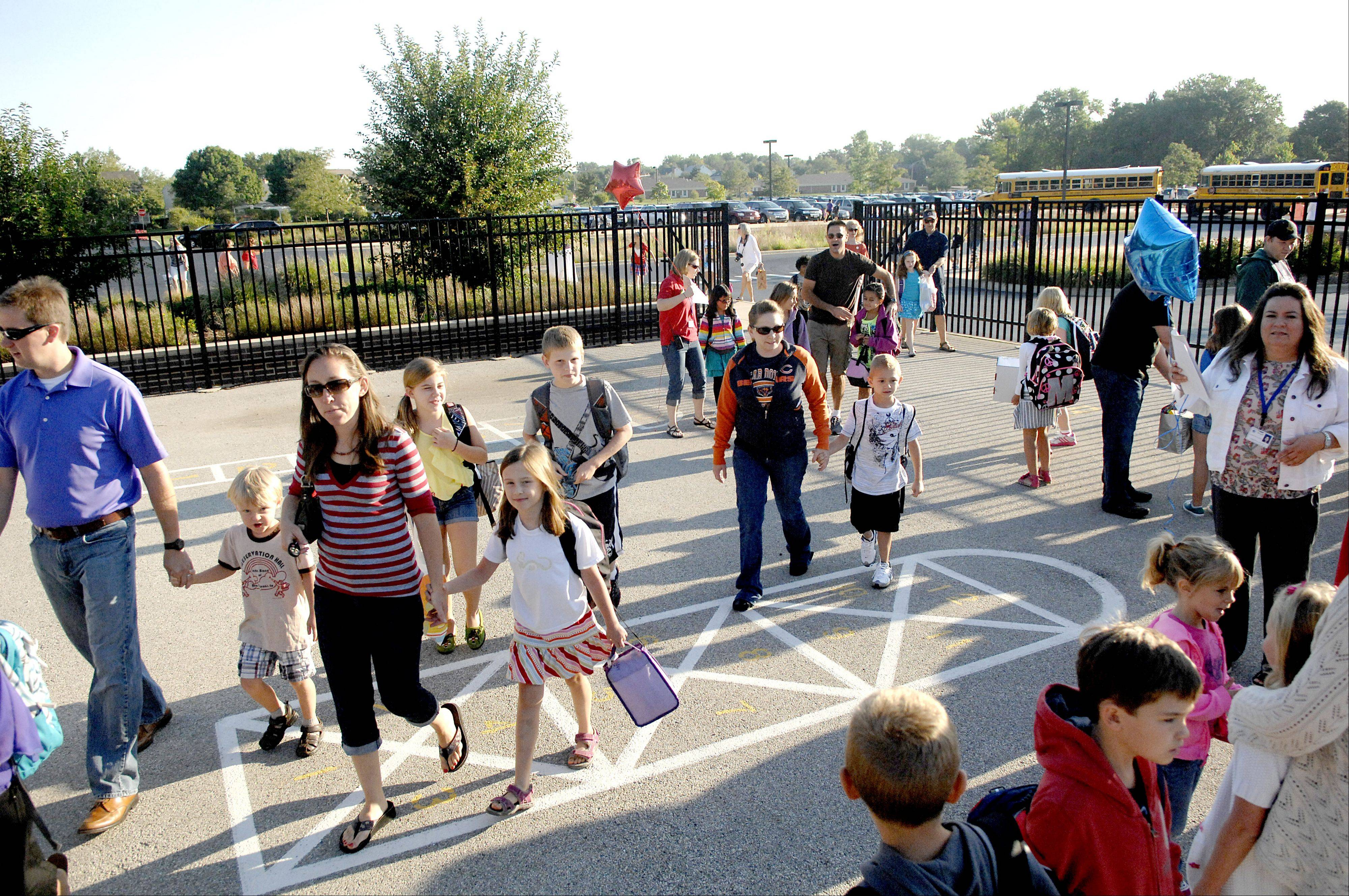 Students and parents file onto the playground to line up with their classes for the first day of school at Williamsburg Elementary School in Geneva on Wednesday, August 22.