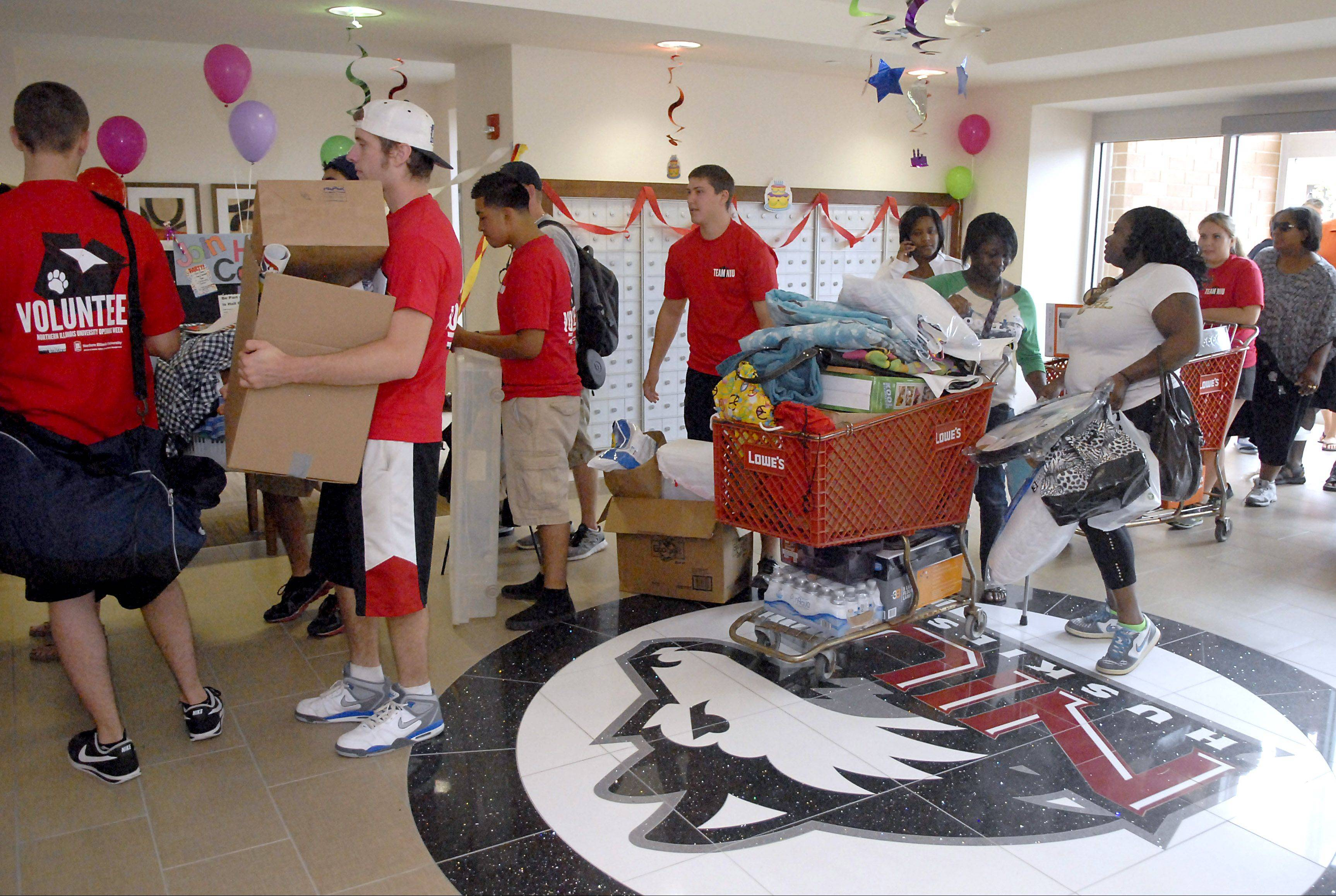 Volunteers help students on move-in day at New Residence Hall West Thursday at Northern Illinois University in DeKalb.