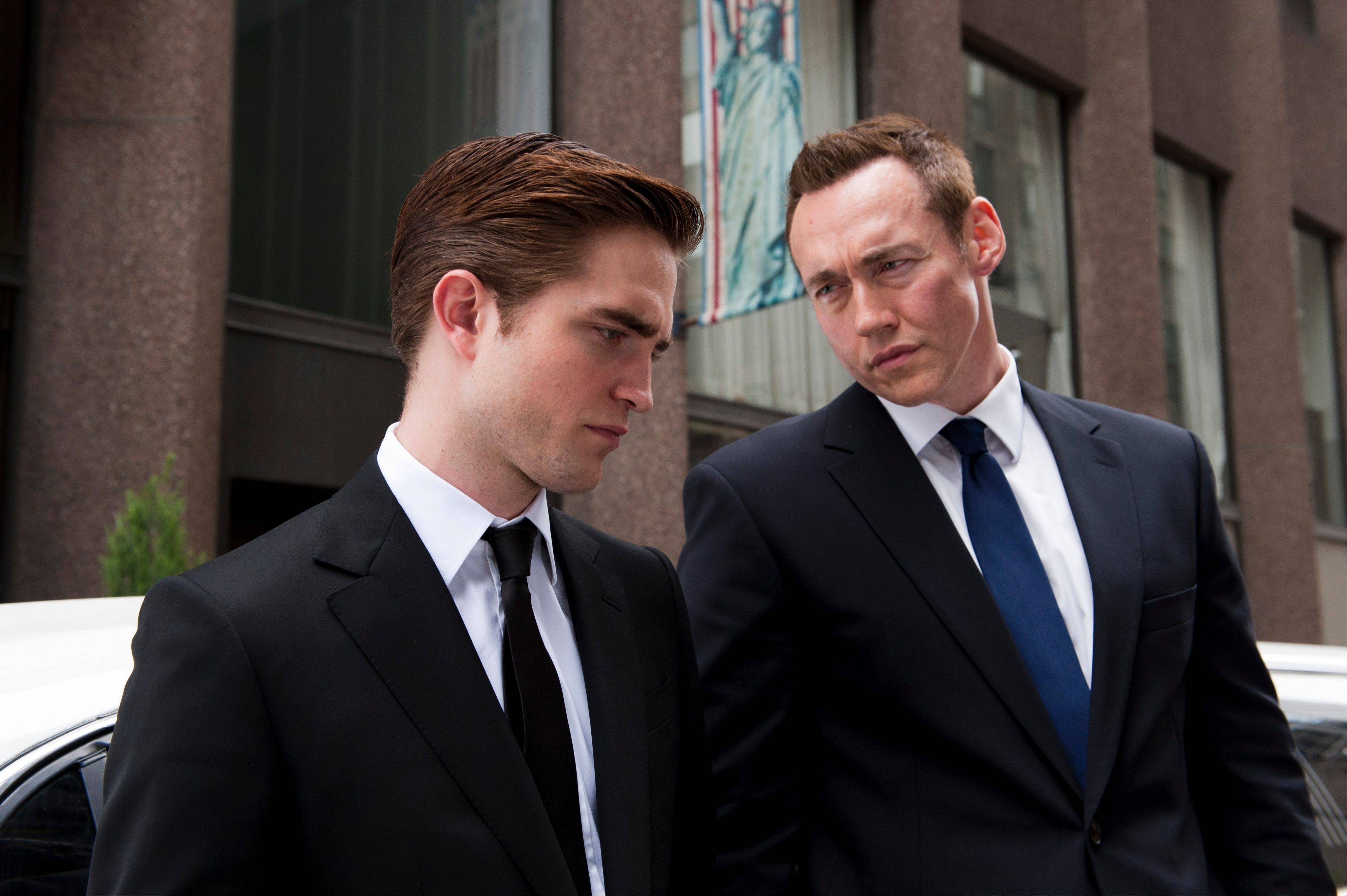 "Rich Eric Packer (Robert Pattinson, left) and his driver (Kevin Durand) encounter various challenges in getting across Manhattan in ""Cosmopolis."""