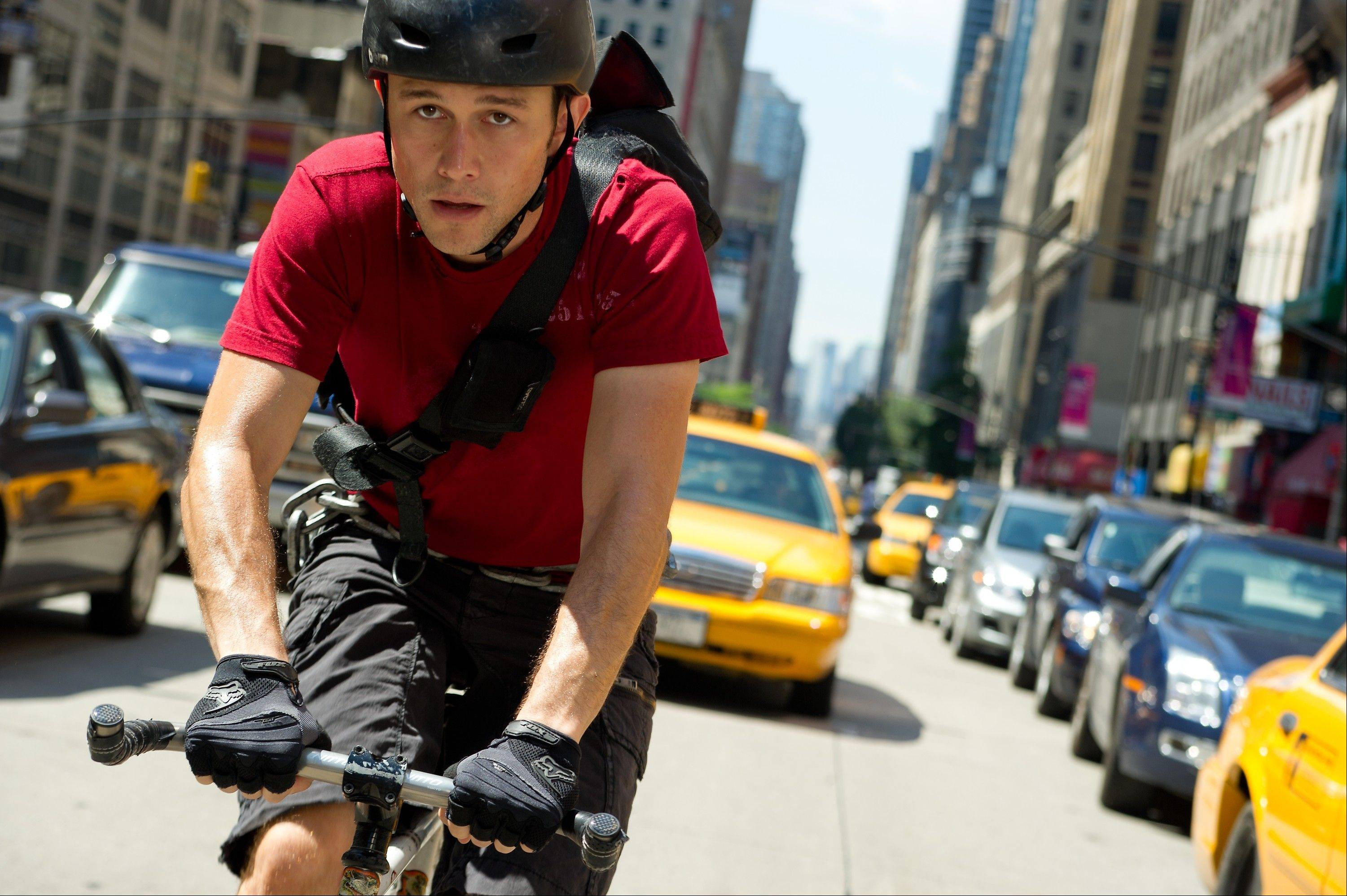 "Wilee (Joseph Gordon-Levitt) takes to the streets of New York to deliver a mystery envelope in David Koepp's stunt-stuffed thriller ""Premium Rush."""