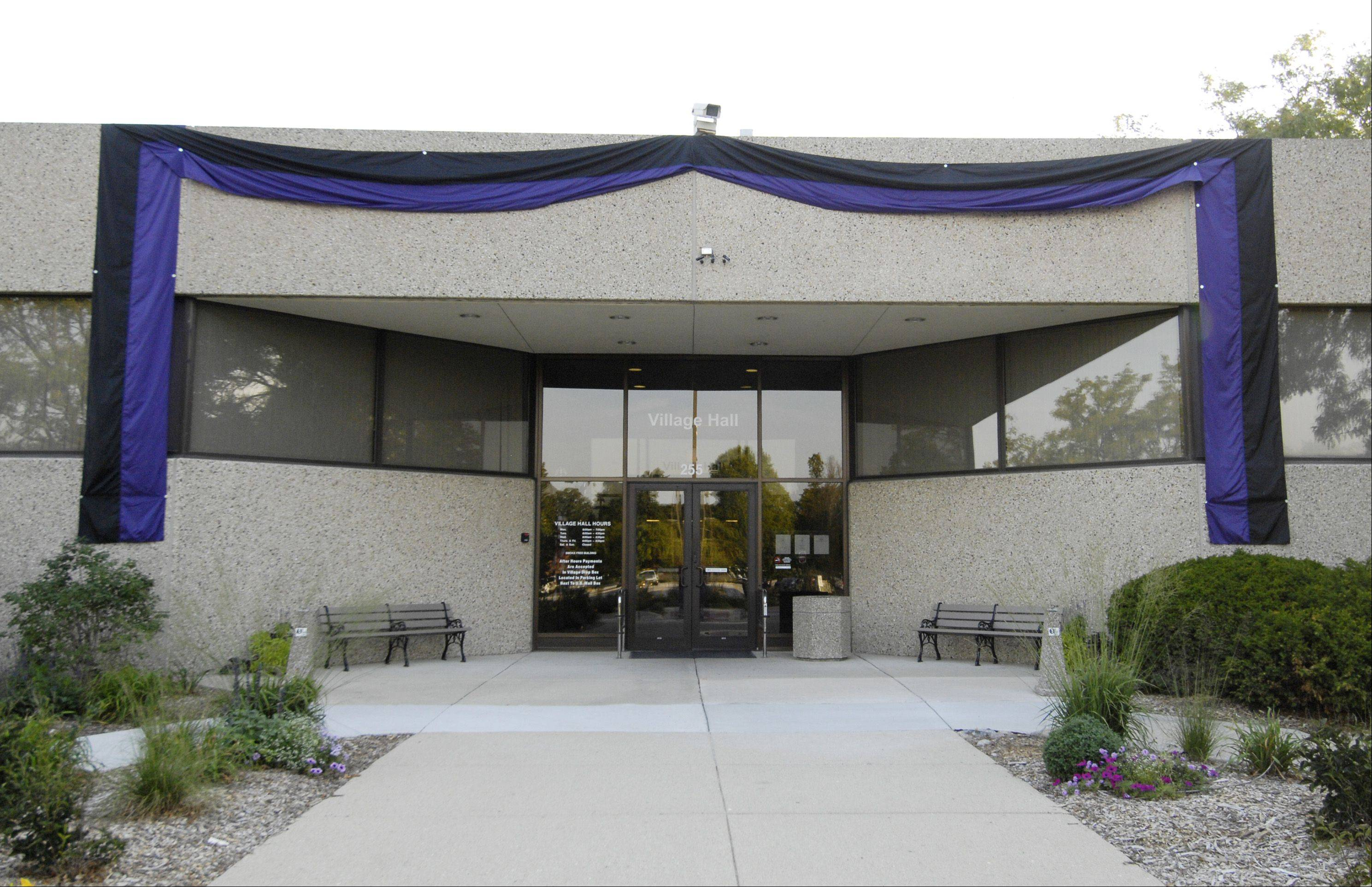 Black and purple bunting drapes Lombard village hall in memory of Village President Bill Mueller who died August 18.