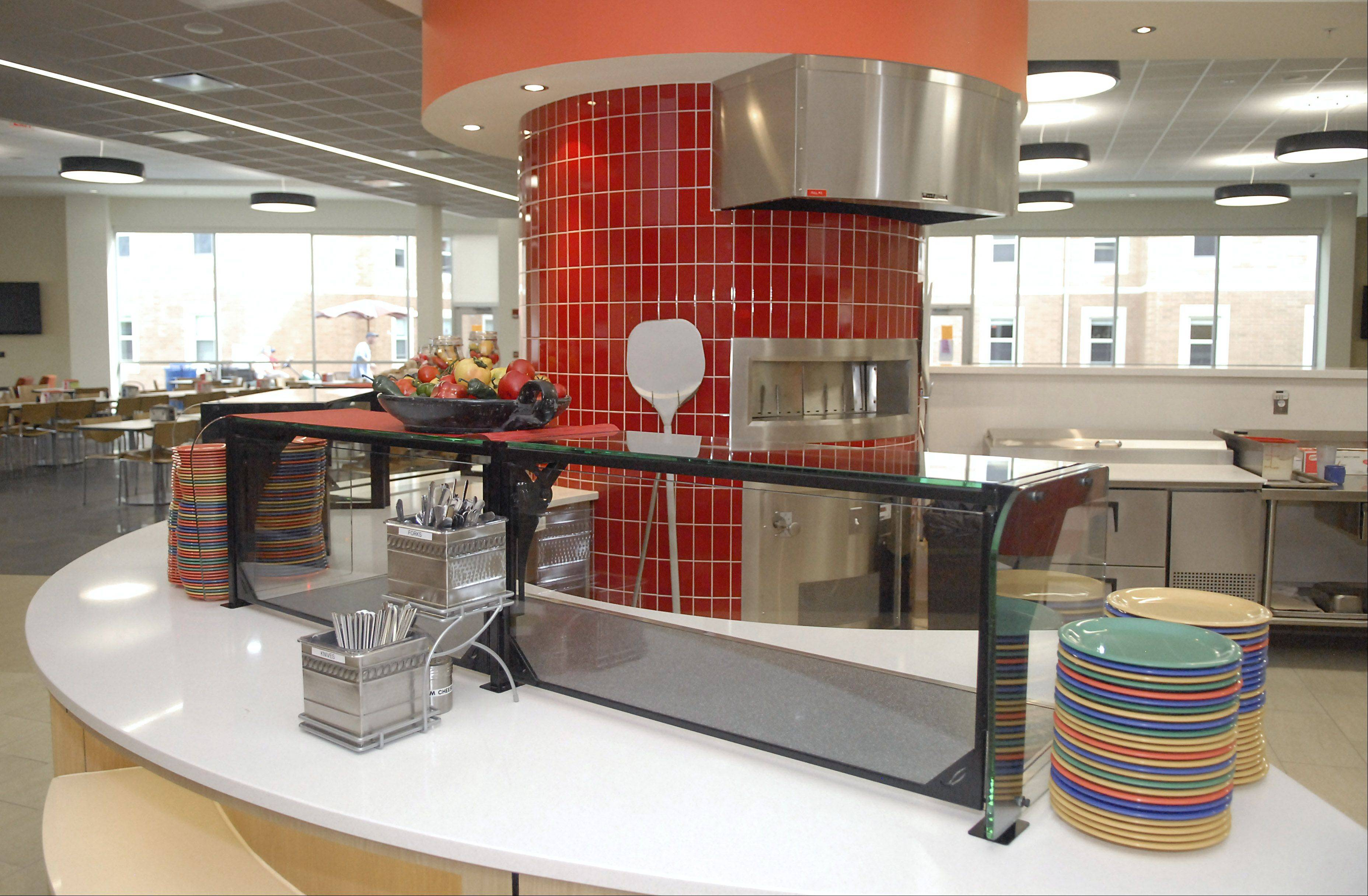 The red-bricked area contains a pizza oven in the cafeteria of the New Residence Hall Community Center at Northern Illinois University in DeKalb on Thursday, August 23.