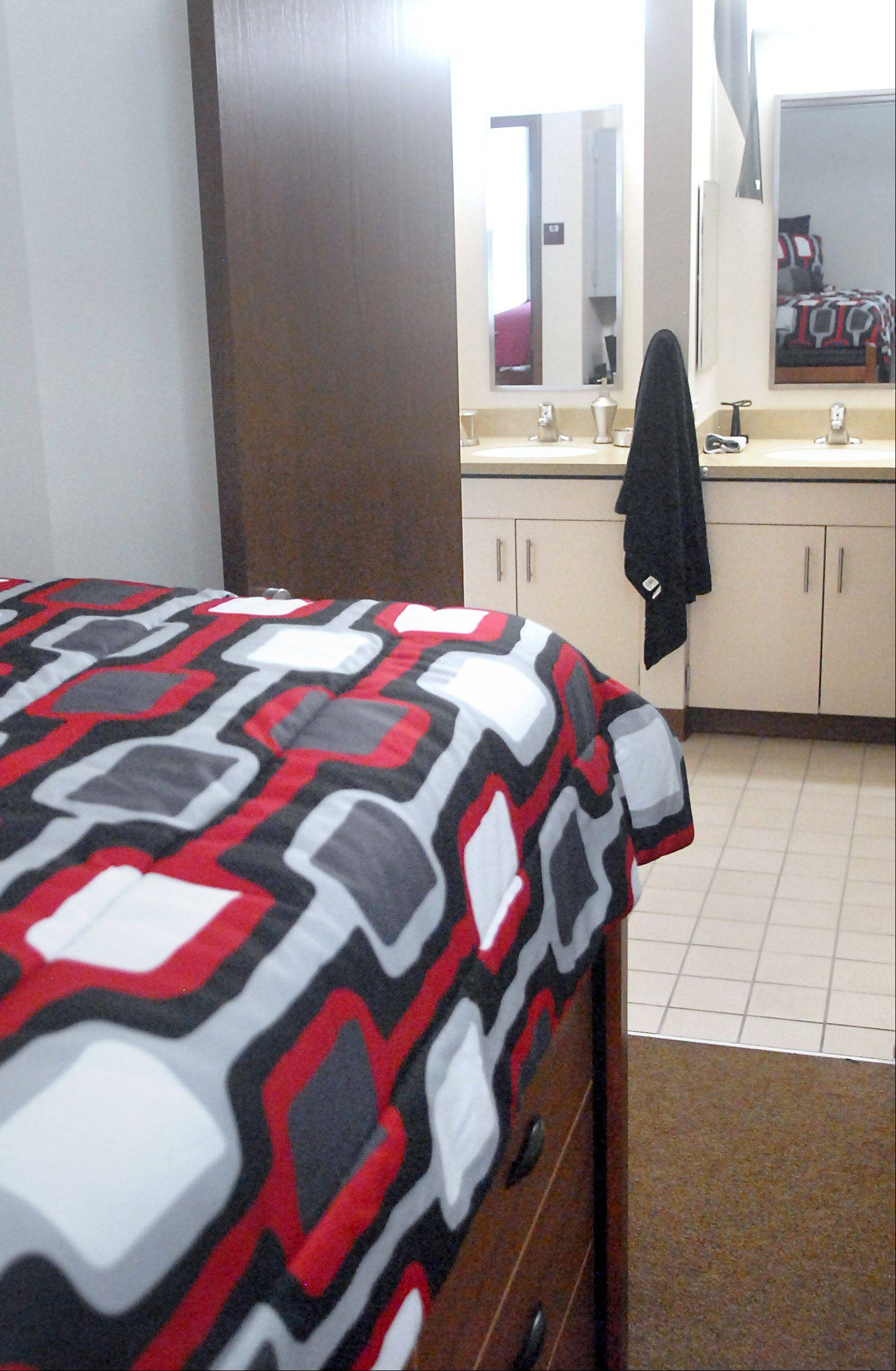 A dorm room is pictured at New Residence Hall West at Northern Illinois University in DeKalb on Thursday, August 23. Students have their own bedrooms and share a bathroom with one other person.