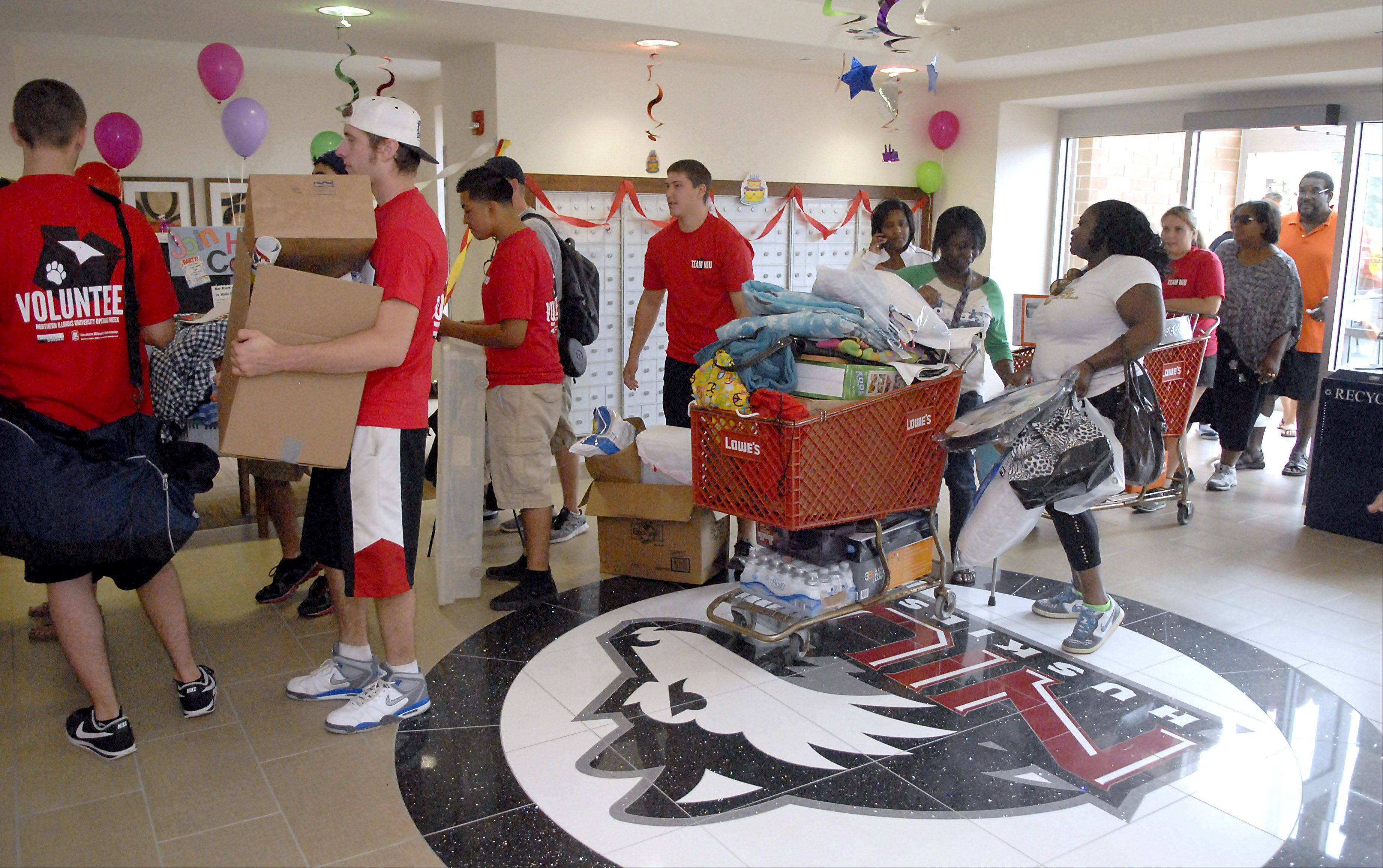 Volunteers help students on move-in day at New Residence Hall West at Northern Illinois University in DeKalb on Thursday, August 23.