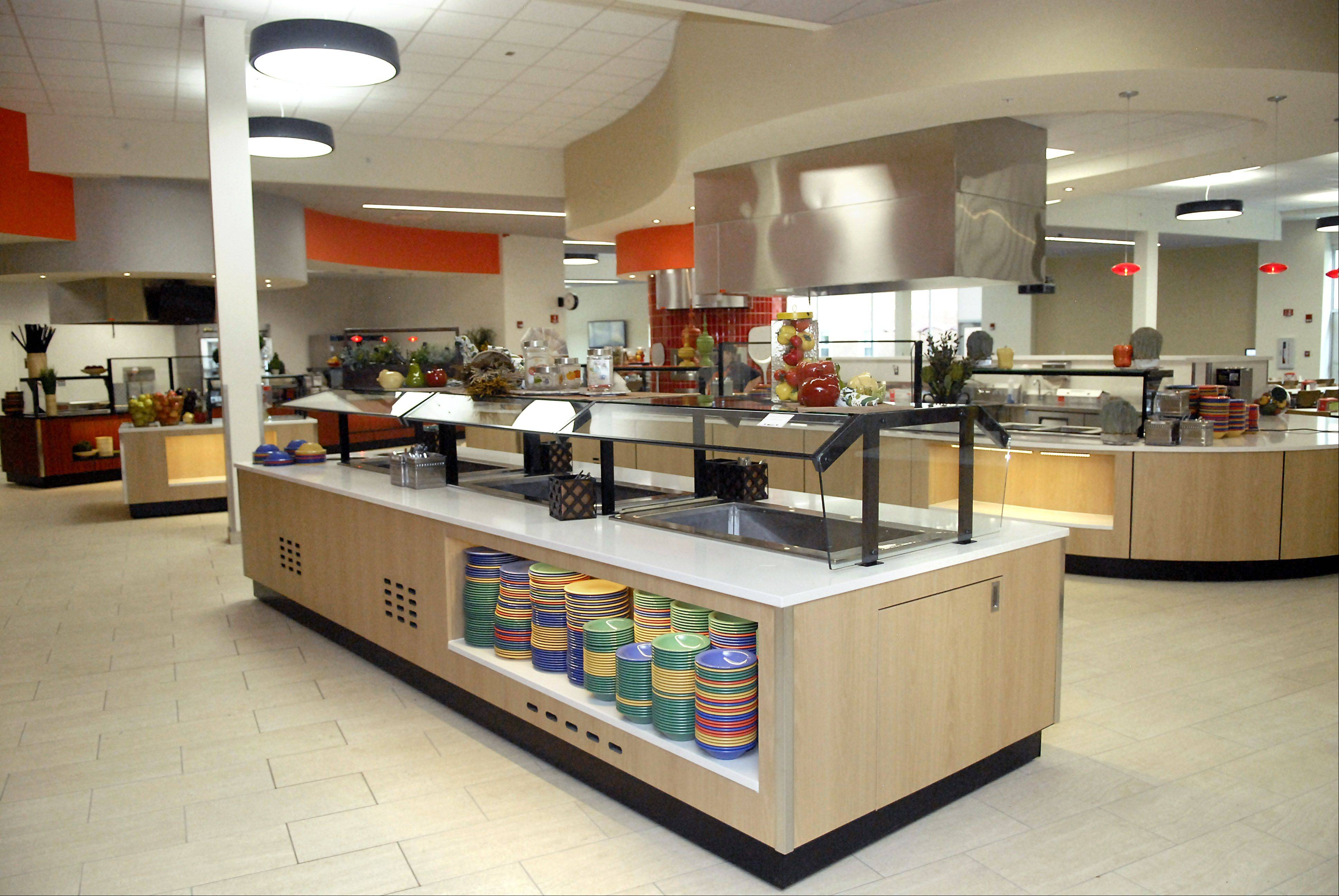 The cafeteria at the New Residence Hall Community Center at Northern Illinois University in DeKalb on Thursday, August 23. There are several different food stations, including a salad bar, fried foods, mongolian food, and a pizza oven.