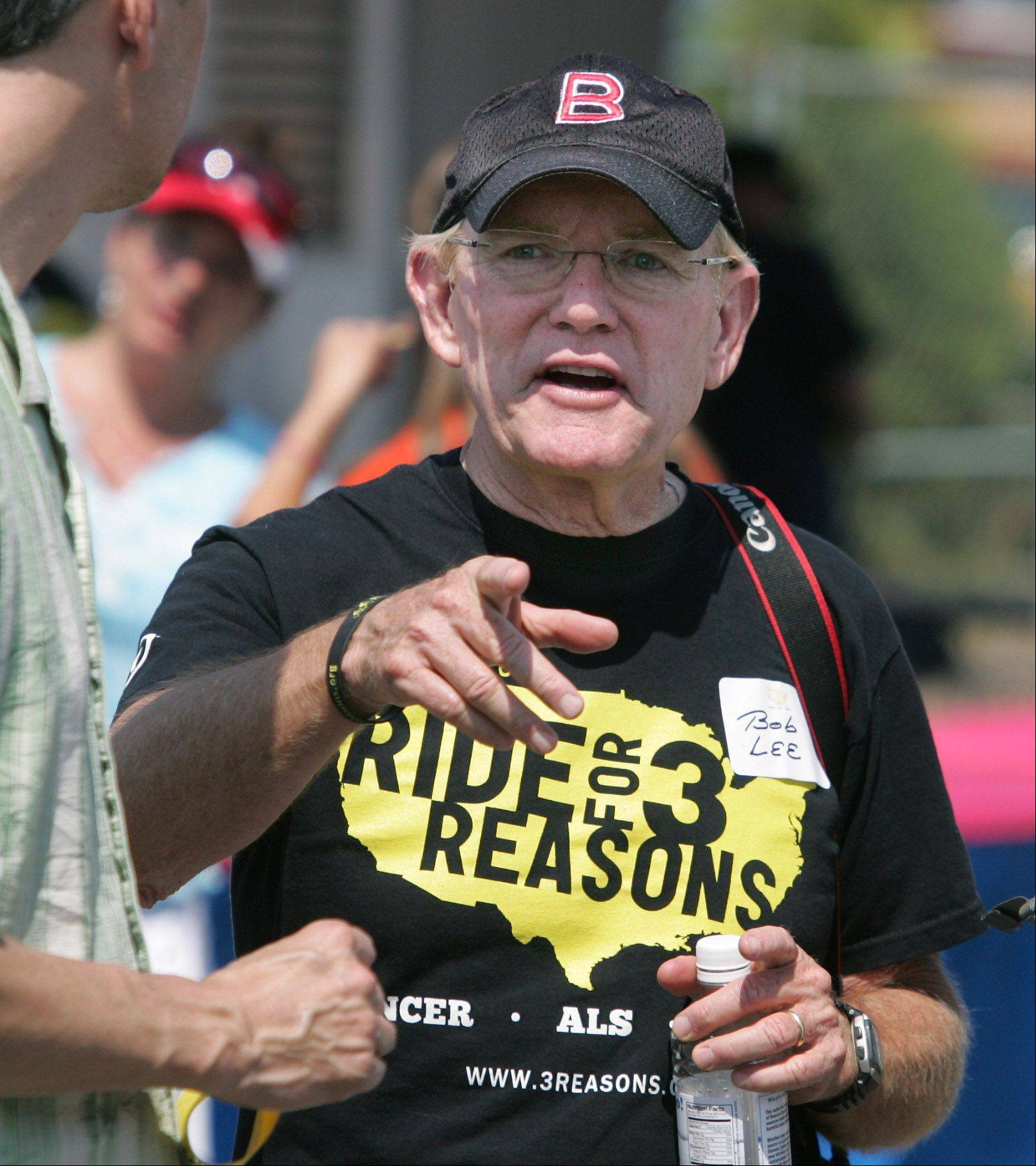Bob Lee discusses his Ride for 3 Reasons with fellow residents at Barrington's Fourth of July Festival last month. Lee's ride, which will raise money for ALS and cancer research, as well as hospice care, begins Sept. 5 in Vancouver, Canada.
