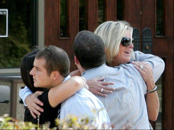 Mourners gather outside the funeral for Megan Boken at St. Michael Church in Wheaton on Thursday.