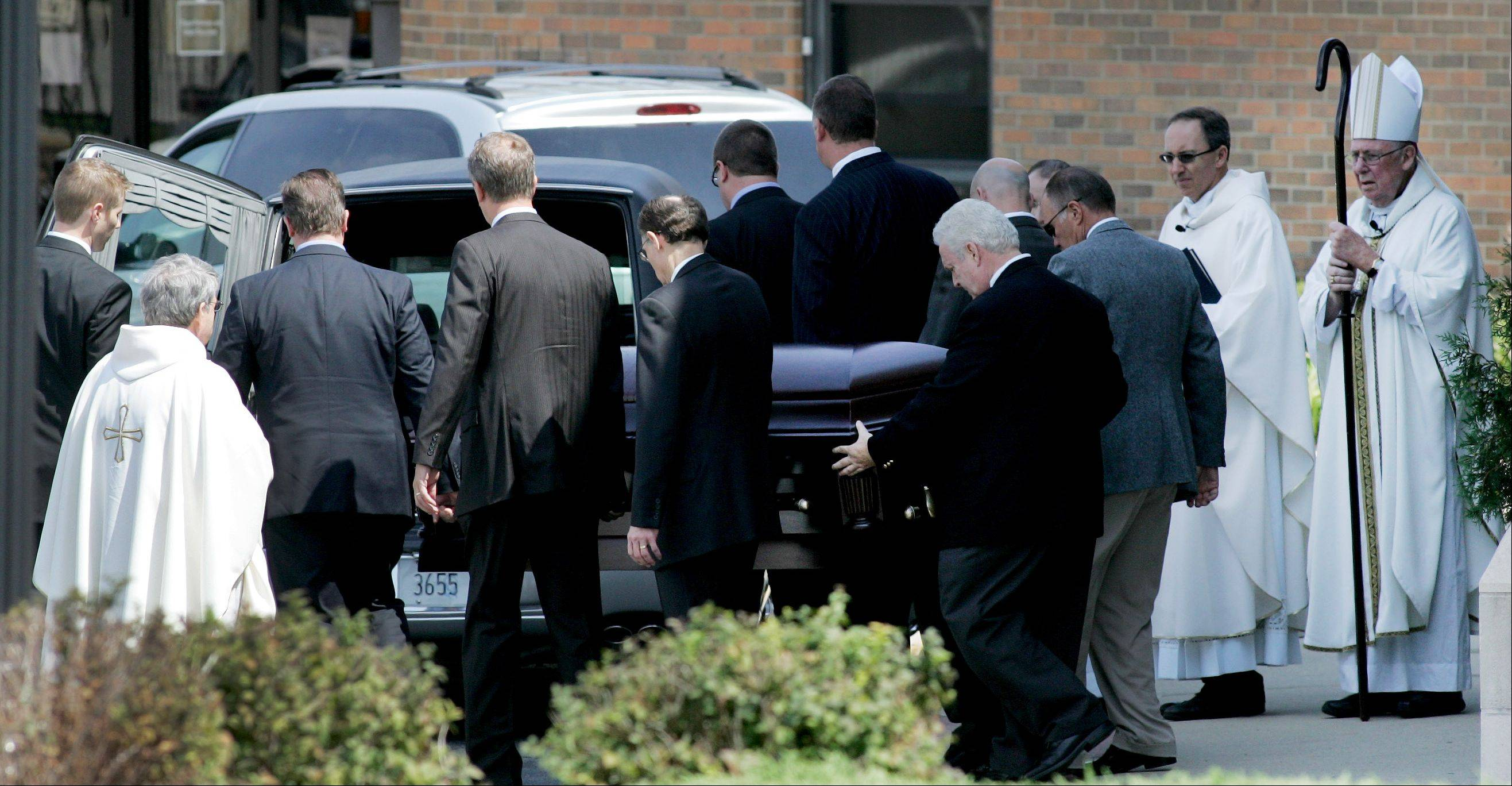 The casket of Megan Boken is placed in a hearse after her funeral at St. Michael Church in Wheaton on Thursday.