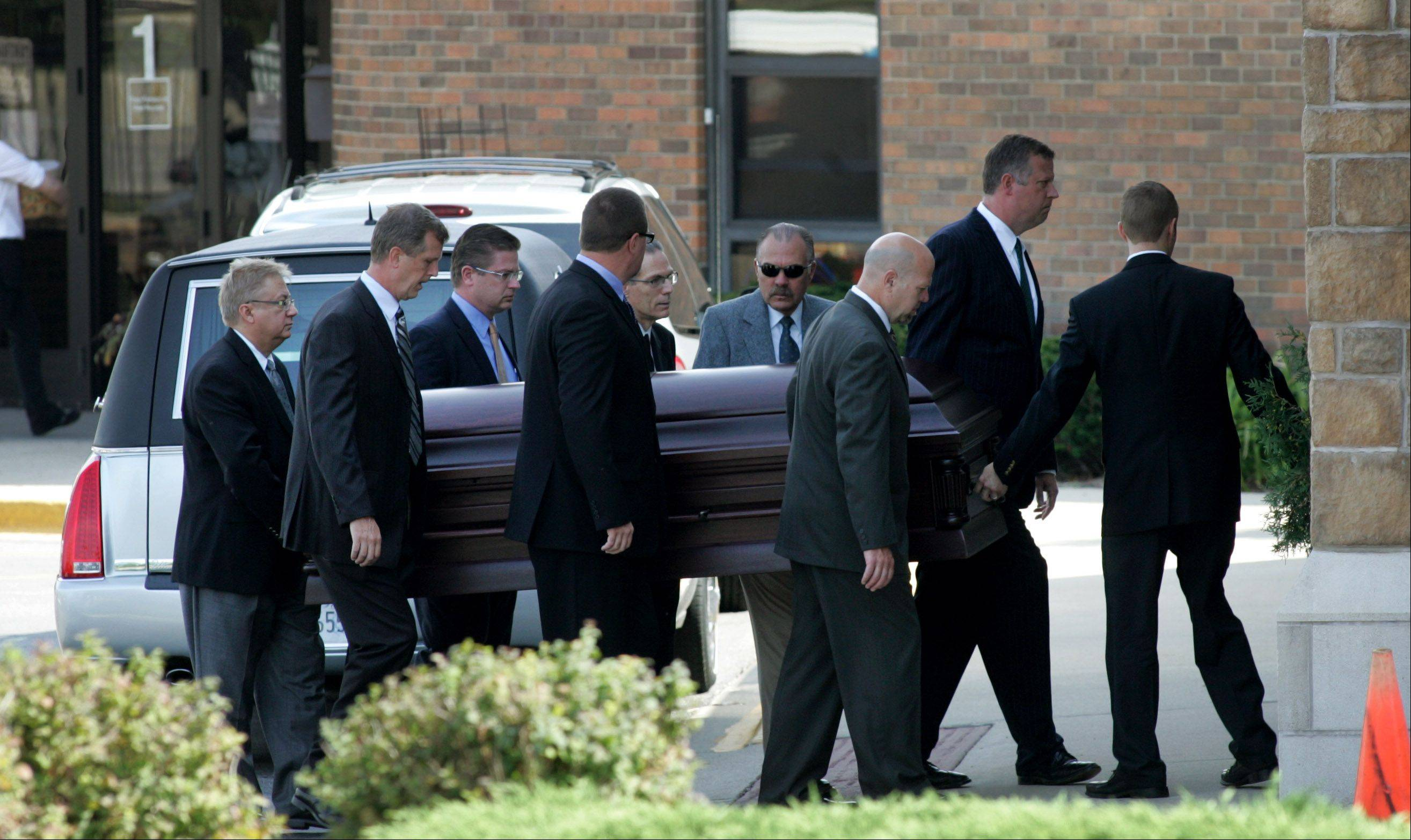 The casket of Megan Boken is carried into St. Michael Church for her funeral in Wheaton on Thursday.