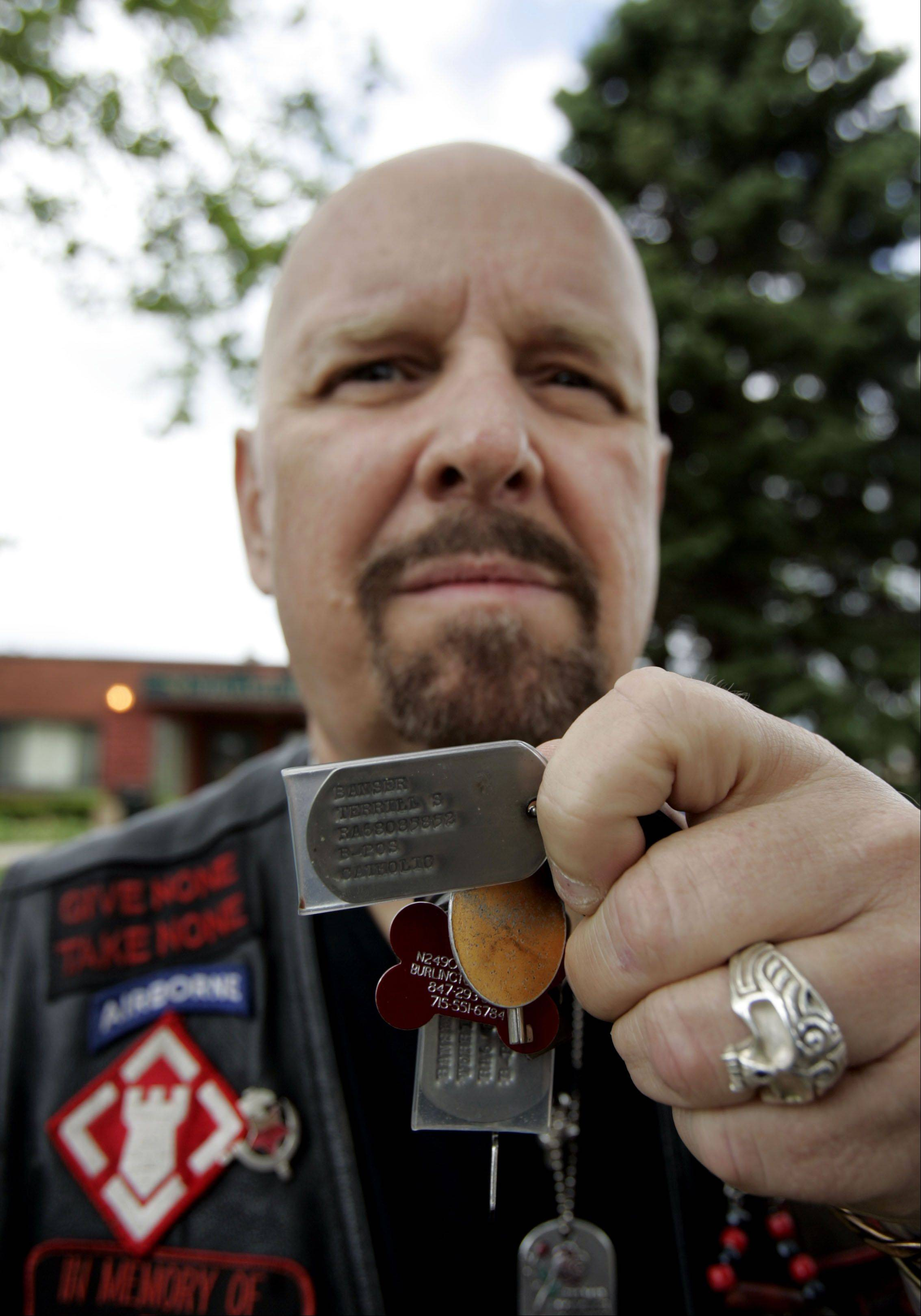 "Antioch native Terrill ""Joker"" Banser, showing off his dog tag from Vietnam in 2011, organized a fundraiser Saturday in Lake Geneva, Wis. to benefit the Chaplain's Fund at the veteran's hospital in North Chicago."
