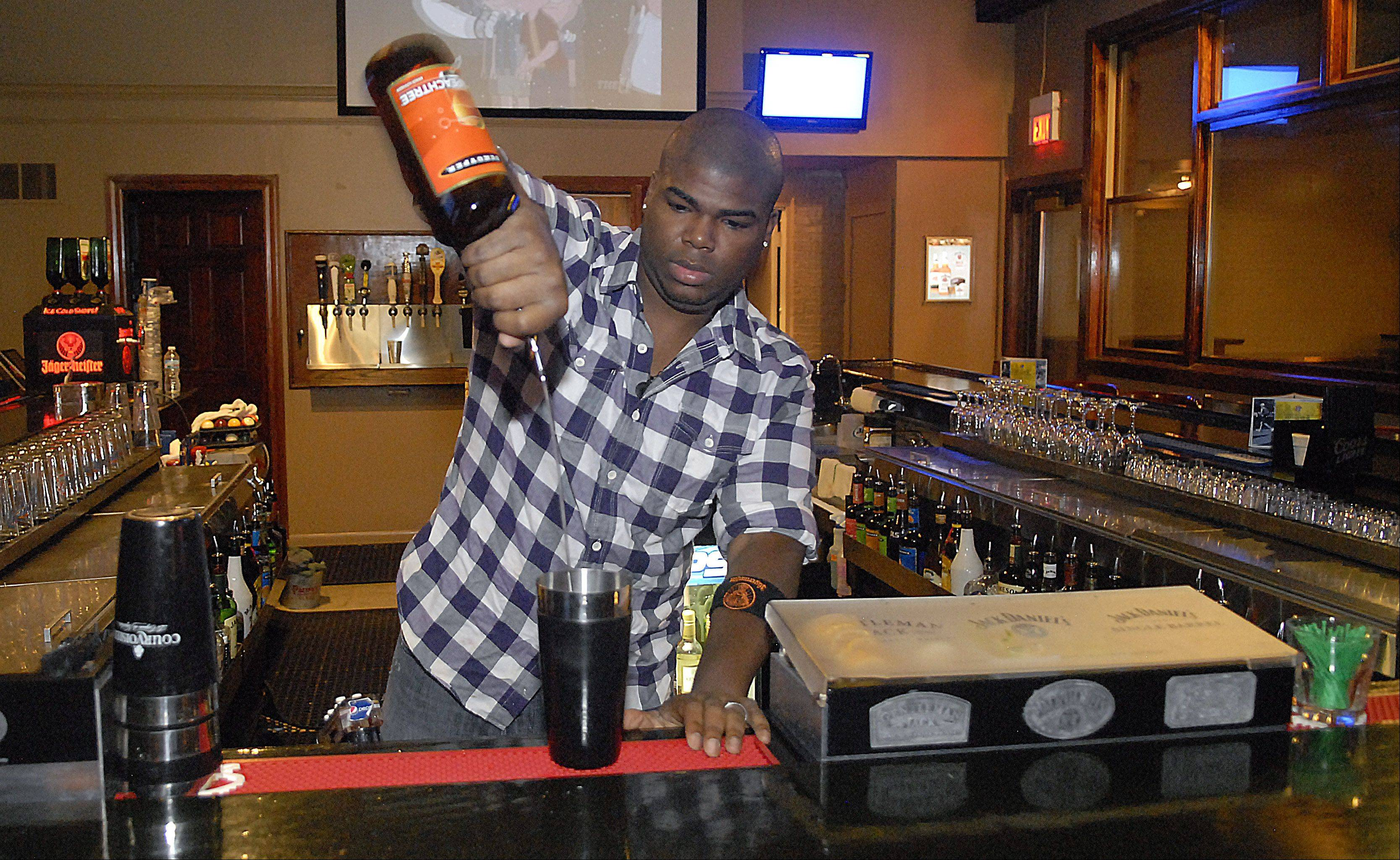 Bartender De Aire' O'Brien pours a drink at River Rockhouse in St. Charles.