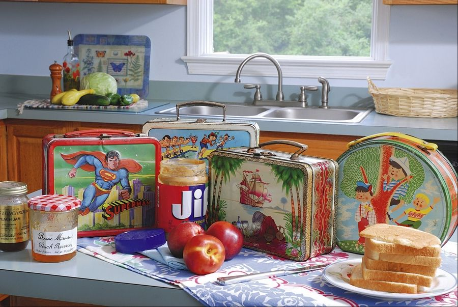 Back in the day, we toted our lunches to school in metal boxes adorned with cartoon characters or in brown paper sacks.