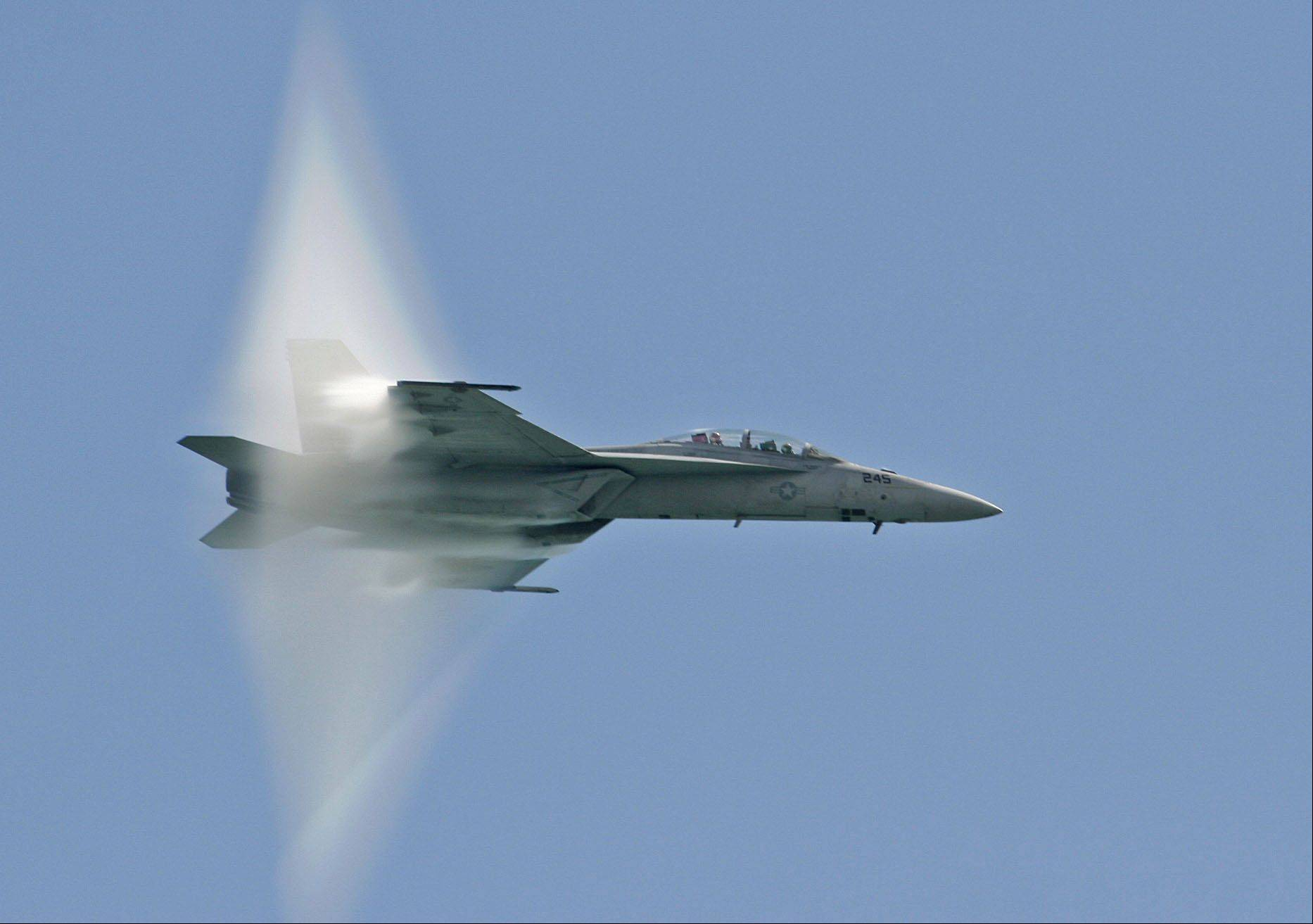 An Air Force jet creates an interesting effect during the Air & Water Show on Friday, August 17, 2012.