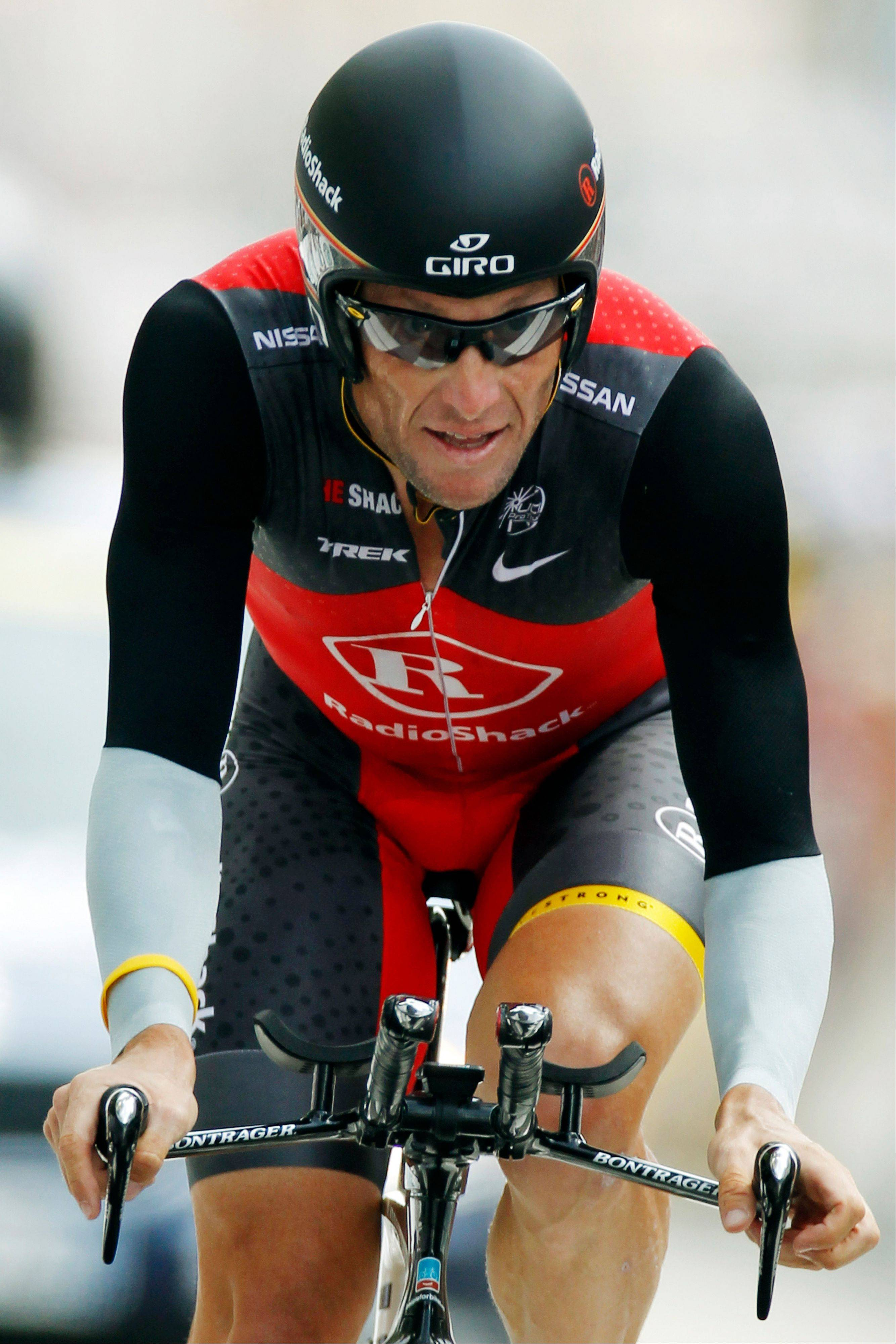 In this July 24, 2010, file photo, Lance Armstrong crosses the finish line during the 19th stage of the Tour de France cycling race, an individual time trial over 52 kilometers (32.3 miles), with a start in Bordeaux and finish in Pauillac, south western France.