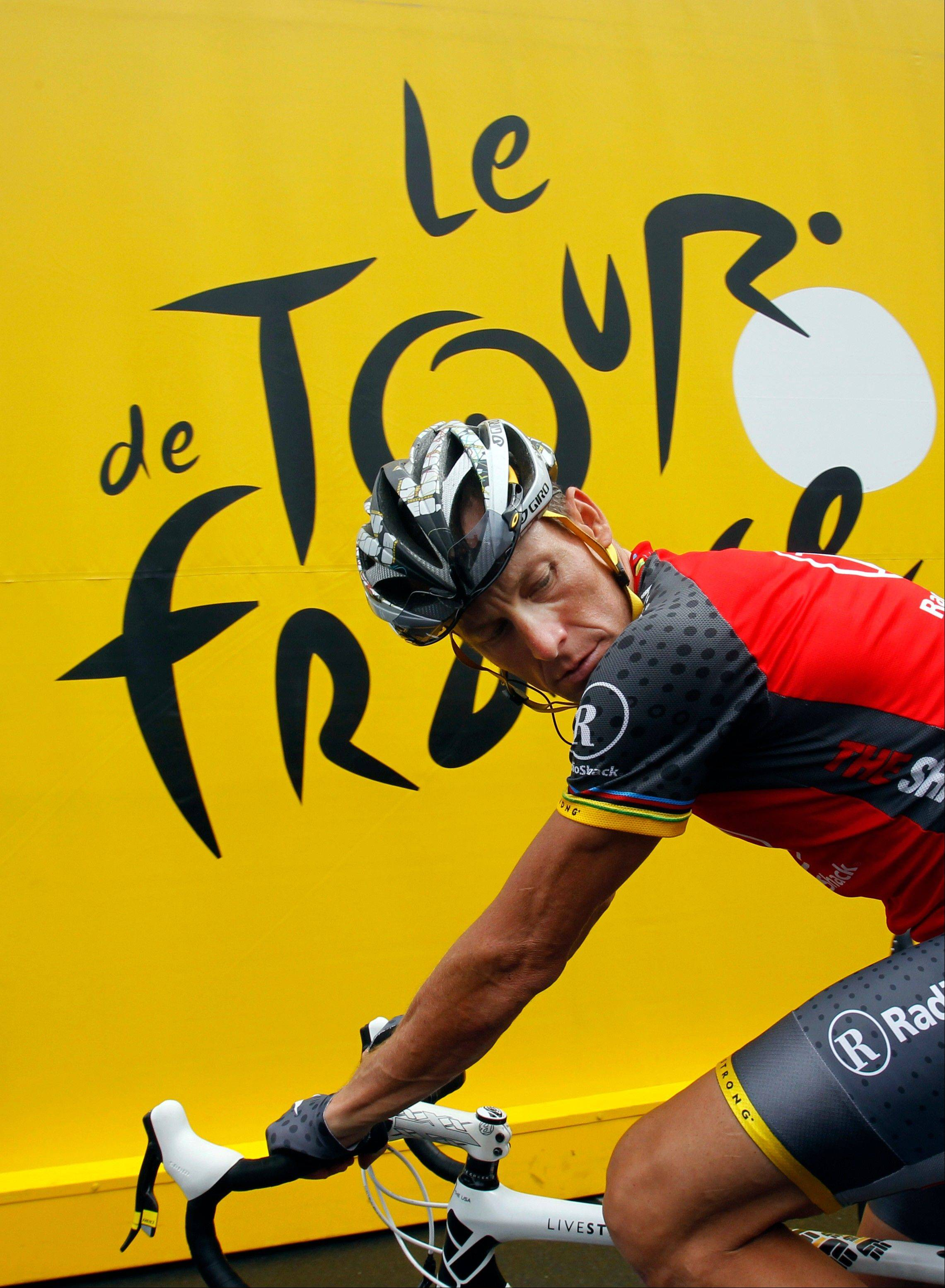 In this July 9, 2010, file photo, Lance Armstrong prepares to take the start of the sixth stage of the Tour de France cycling race over 227.5 kilometers (141.4 miles) with a start in Montargis and finish in Gueugnon, France. Armstrong said on Thursday, Aug. 23, 2012, that he is finished fighting charges from the United States Anti-Doping Agency that he used performance-enhancing drugs during his unprecedented cycling career, a decision that could put his string of seven Tour de France titles in jeopardy.