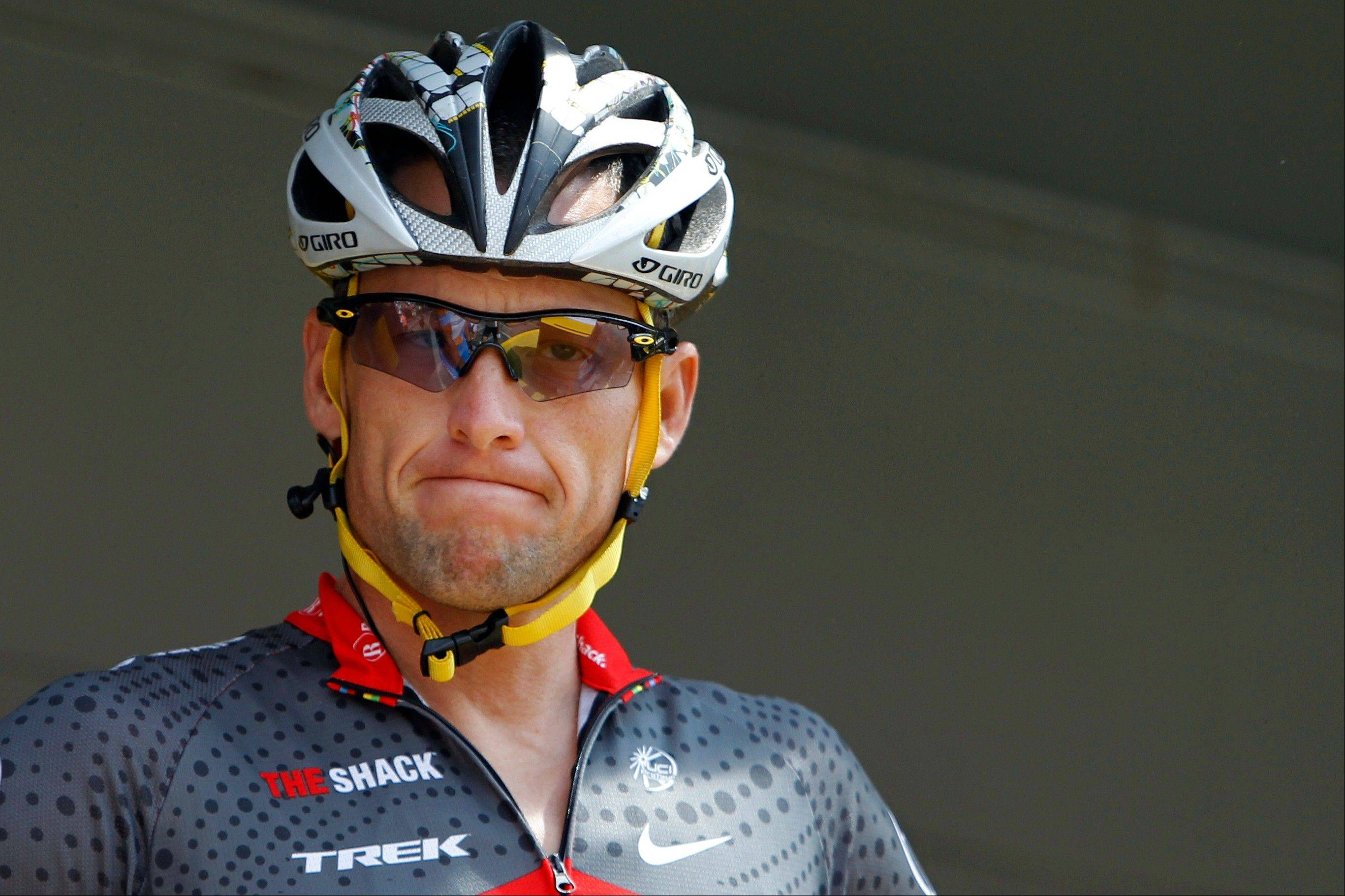 In this July 6, 2010, file photo, Lance Armstrong grimaces prior to the start of the third stage of the Tour de France cycling race in Wanze, Belgium. Armstrong said on Thursday, Aug. 23, 2012, that he is finished fighting charges from the United States Anti-Doping Agency that he used performance-enhancing drugs during his unprecedented cycling career, a decision that could put his string of seven Tour de France titles in jeopardy.