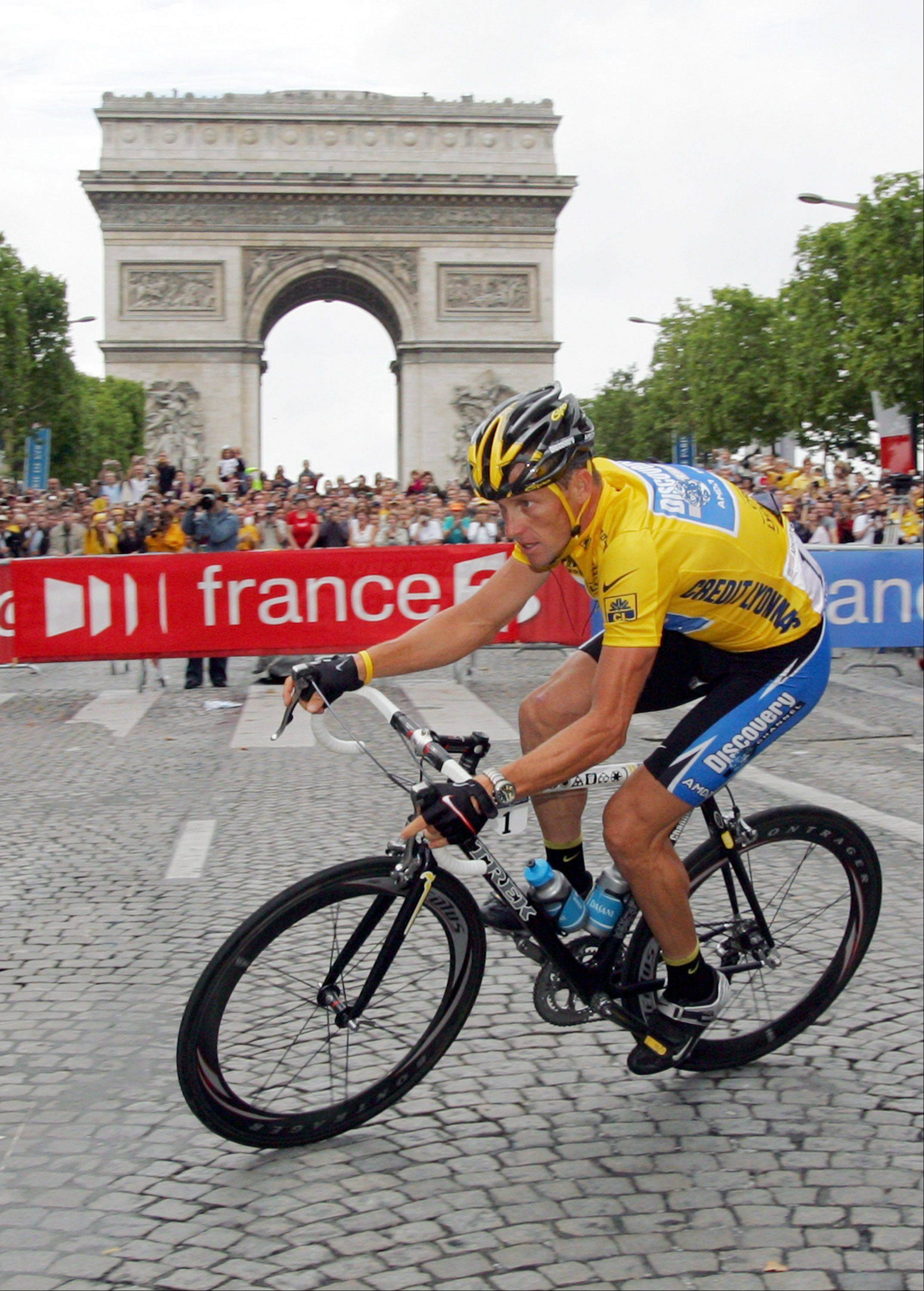 In this July 24, 2005 file photo, overall leader Lance Armstrong, of Austin, Texas, pedals past the Arc de Triomphe in Paris on his way to win his seventh straight the Tour de France cycling race, during the 21st and final stage of the race between Corbeil-Essonnes, south of Paris, and the French capital. Armstrong will ride in the 2009 Tour de France, marking the first time he will compete in that race and the Giro d'Italia in the same year.