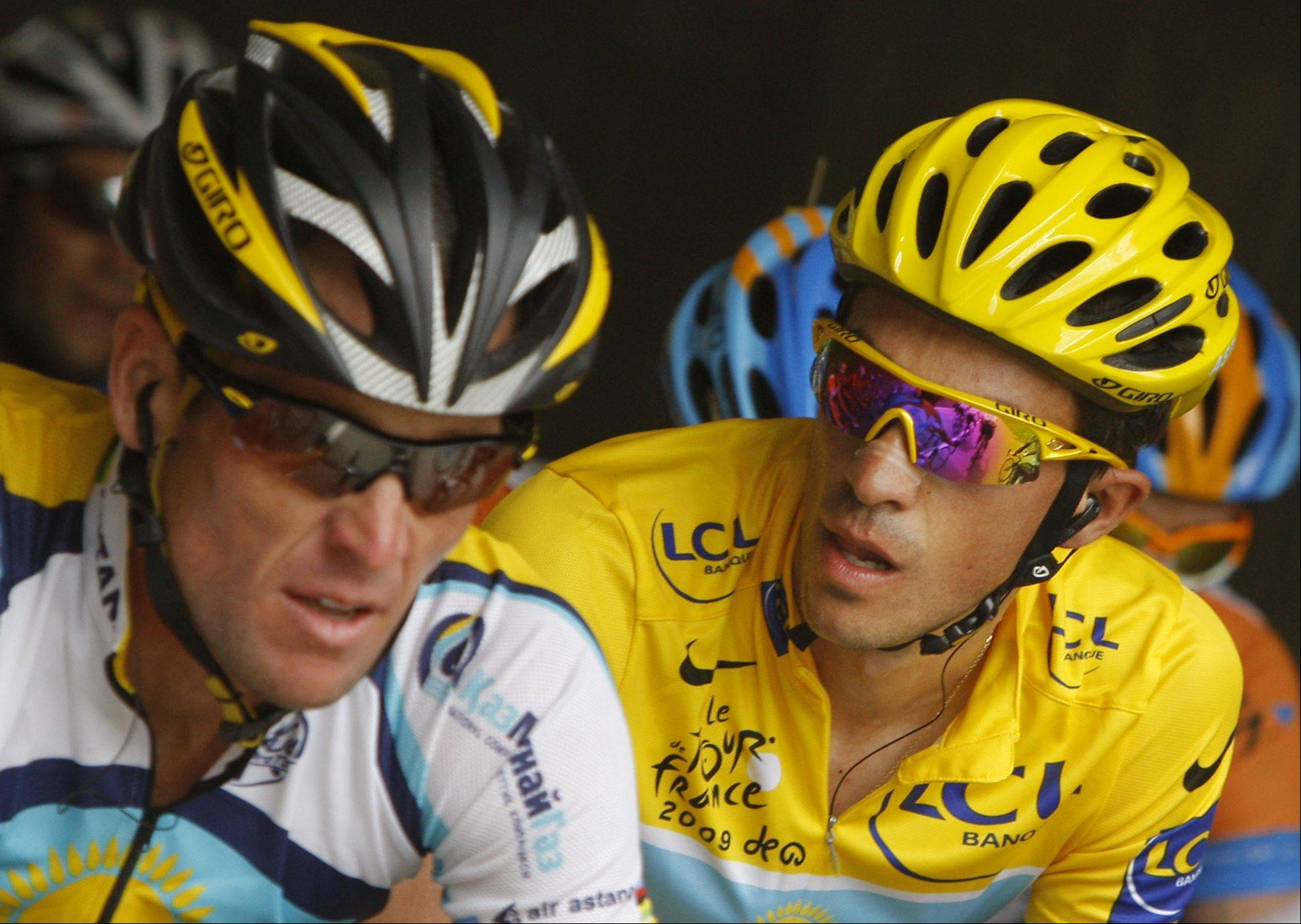 Alberto Contador of Spain, wearing the overall leader's yellow jersey, right, looks at American seven-time Tour de France winner Lance Armstrong, as they climb Grand-Saint-Bernard pass during the 16th stage of the Tour de France cycling race over 159 kilometers (98.8 miles) with start in Martigny, Switzerland and finish in Bourg-Saint-Maurice, Alps region, France, Tuesday July 21, 2009.