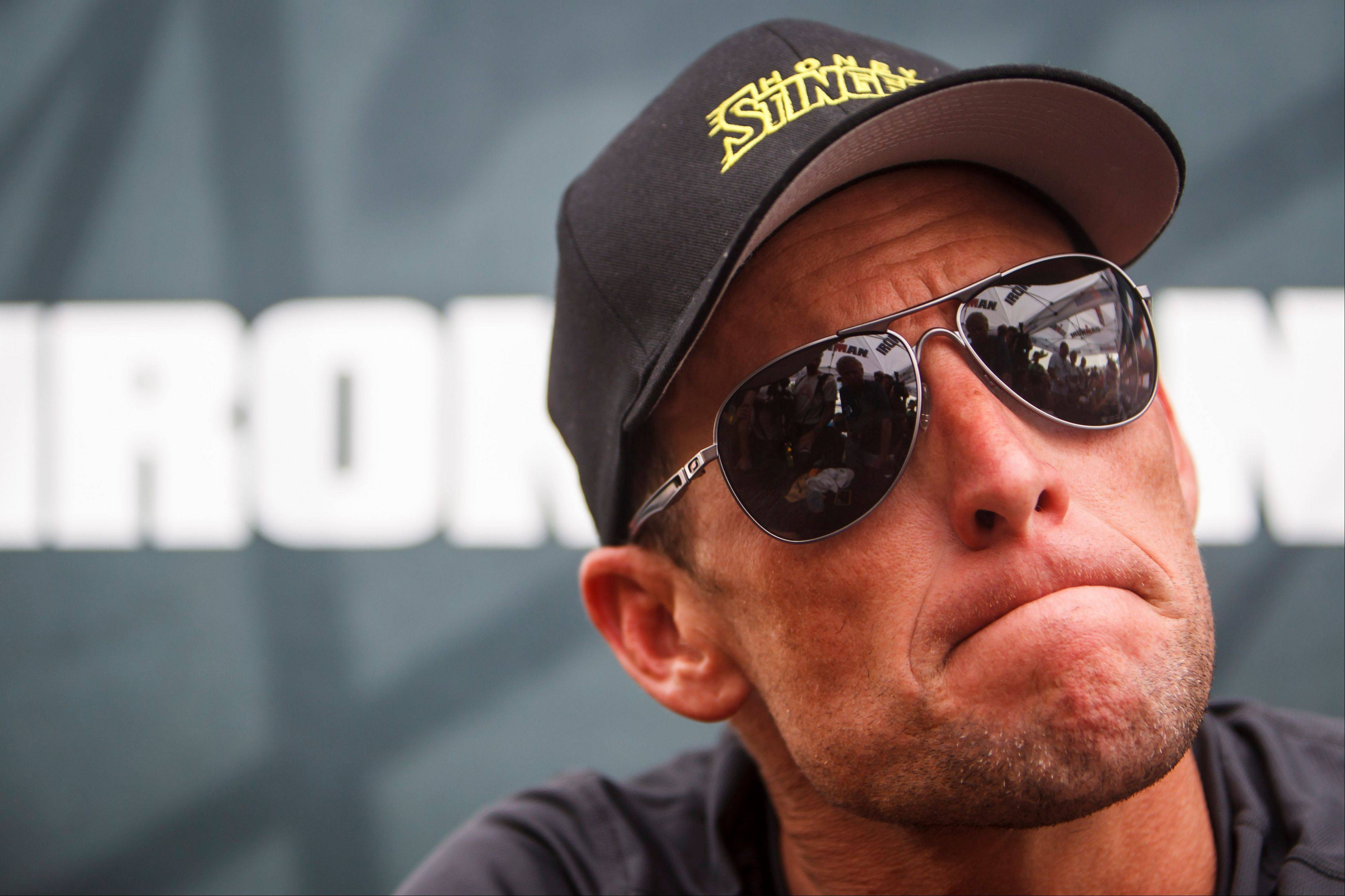 This April 1, 2012 file photo shows seven-time Tour de France champion Lance Armstrong grimacing during a news conference after the Memorial Hermann Ironman 70.3 Texas triathlon in Galveston, Texas. A federal judge in Austin, Texas, has thrown out Lance Armstrong's lawsuit against the U.S. Anti-Doping Agency, an attempt to stop the drug case against the seven-time Tour de France winner.