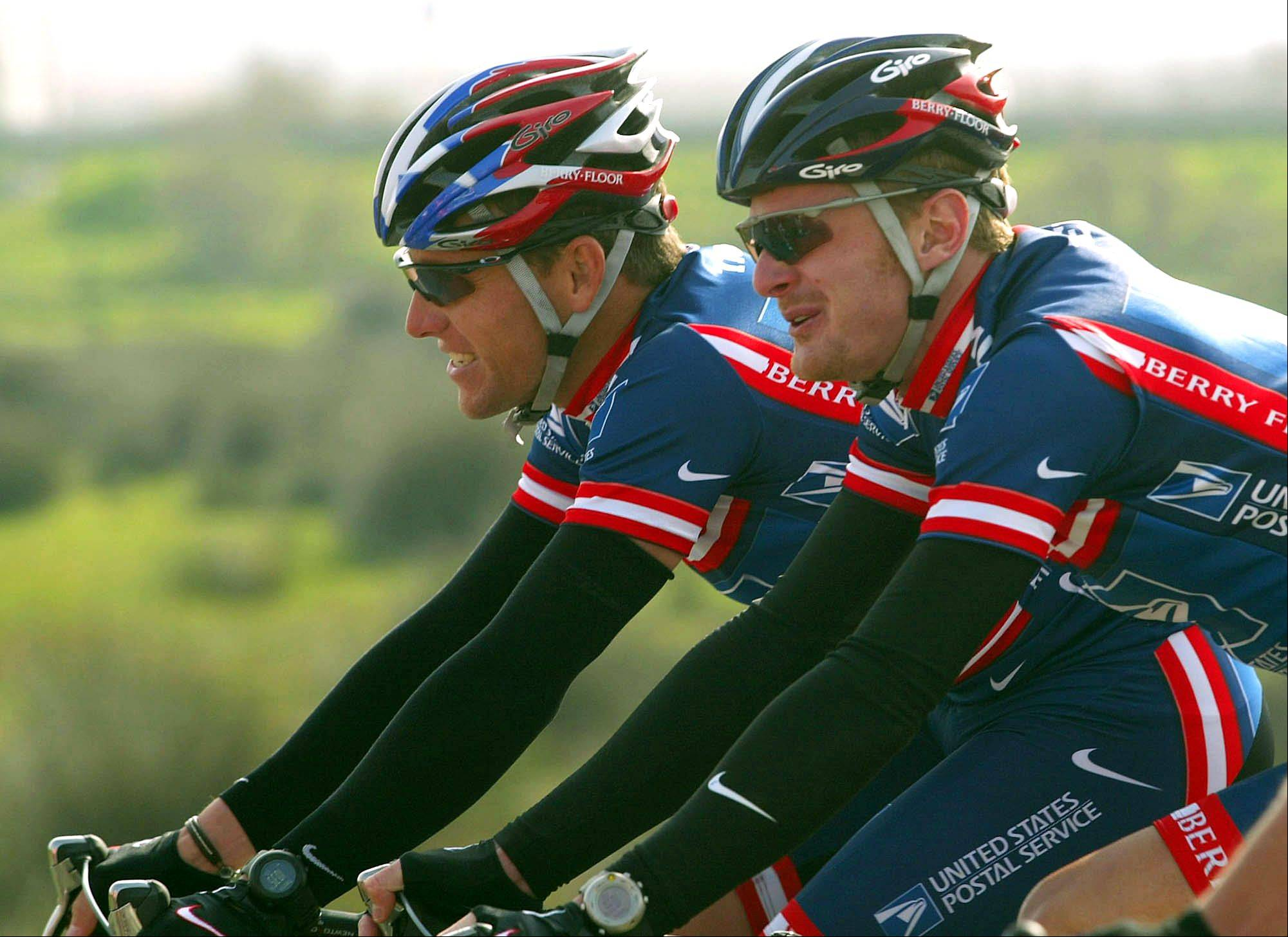 This Feb. 19, 2004, file photo shows Lance Armstrong, left, and Floyd Landis, riding side-by-side during the second stage of the 5-day Tour of the Algarve cycling race in Algarve, southern Portugal. Disgraced American cyclist Floyd Landis has admitted to systematic use of performance-enhancing drugs and accused seven-time Tour de France champion Lance Armstrong of involvement in doping, the Wall Street Journal reported Thursday, May 20, 2010.