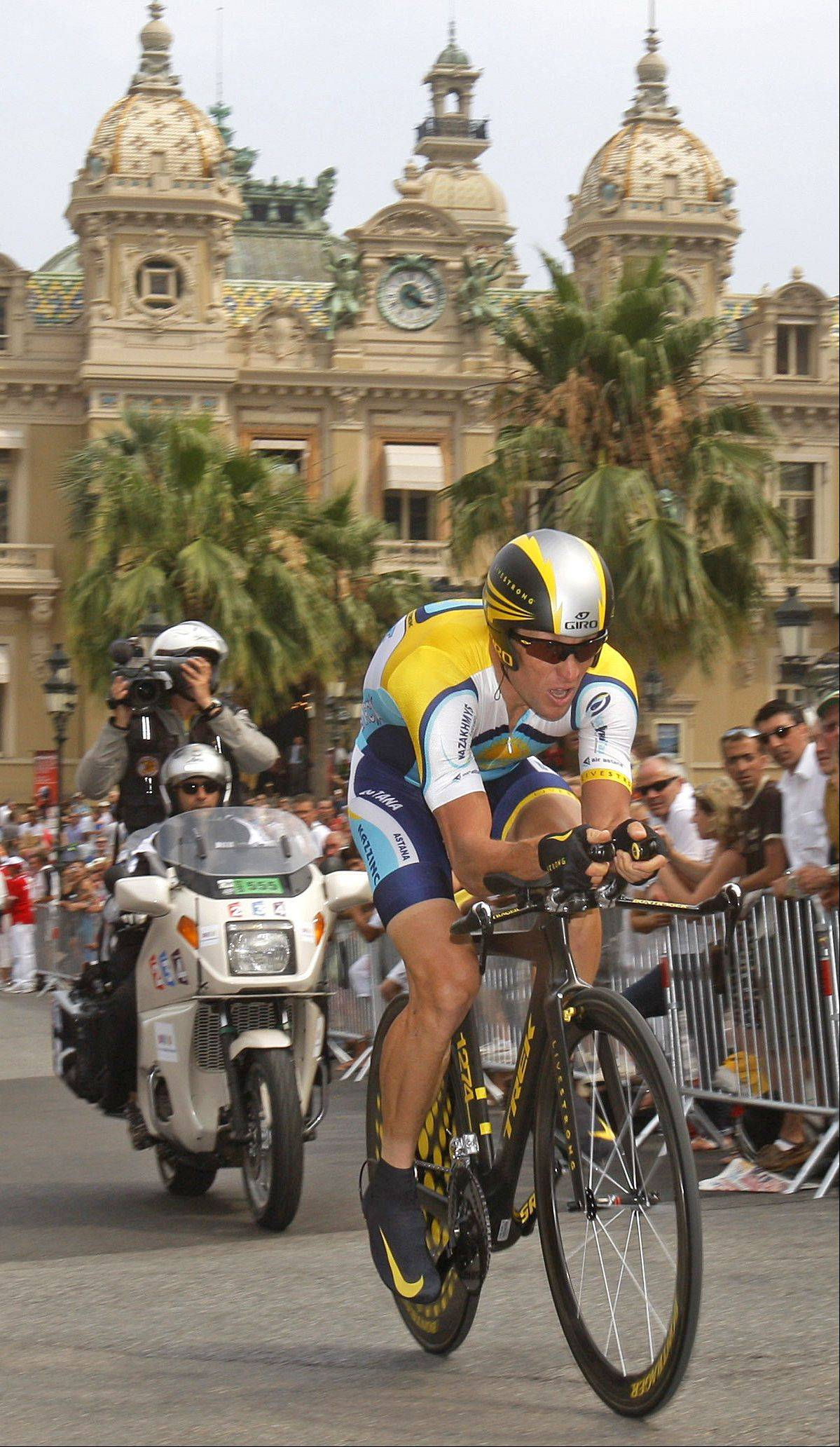 American seven-time Tour de France winner Lance Armstrong strains as he passes Monaco's Casino during the first stage of the Tour de France cycling race, an individual time trial of 15.5 kilometers (9.63 miles) with start and finish in Moncao, Saturday July 4, 2009.