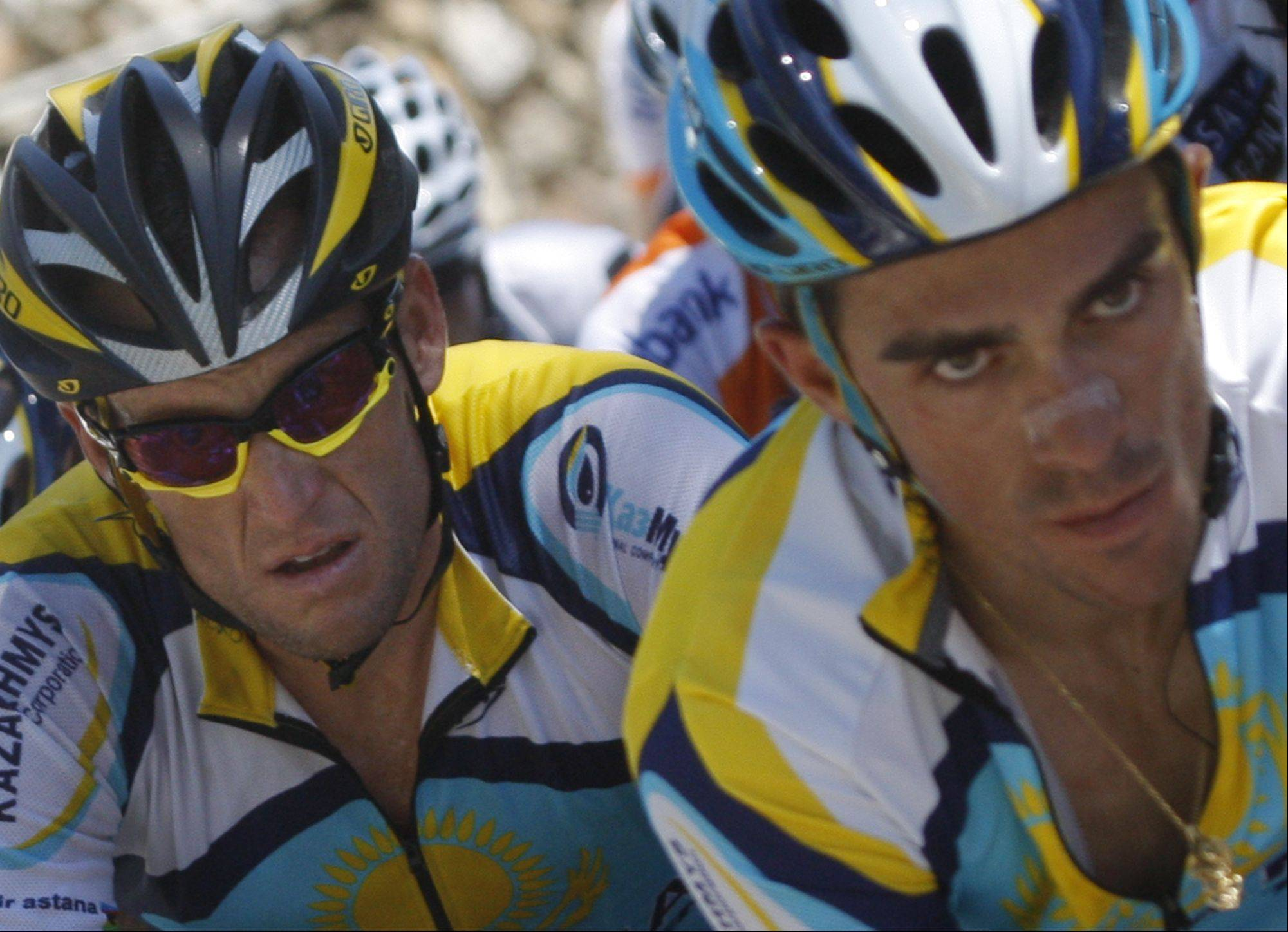 American seven-time Tour de France winner Lance Armstrong, left, and teammate and rival Alberto Contador of Spain, right, climb towards Col de Port , France, during the 8th stage of the Tour de France cycling race over 176.5 kilometers (109.7 miles) with start in Andorra and finish in Saint-Girons, France, Saturday July 11, 2009. There never was any love lost between the two teammates.