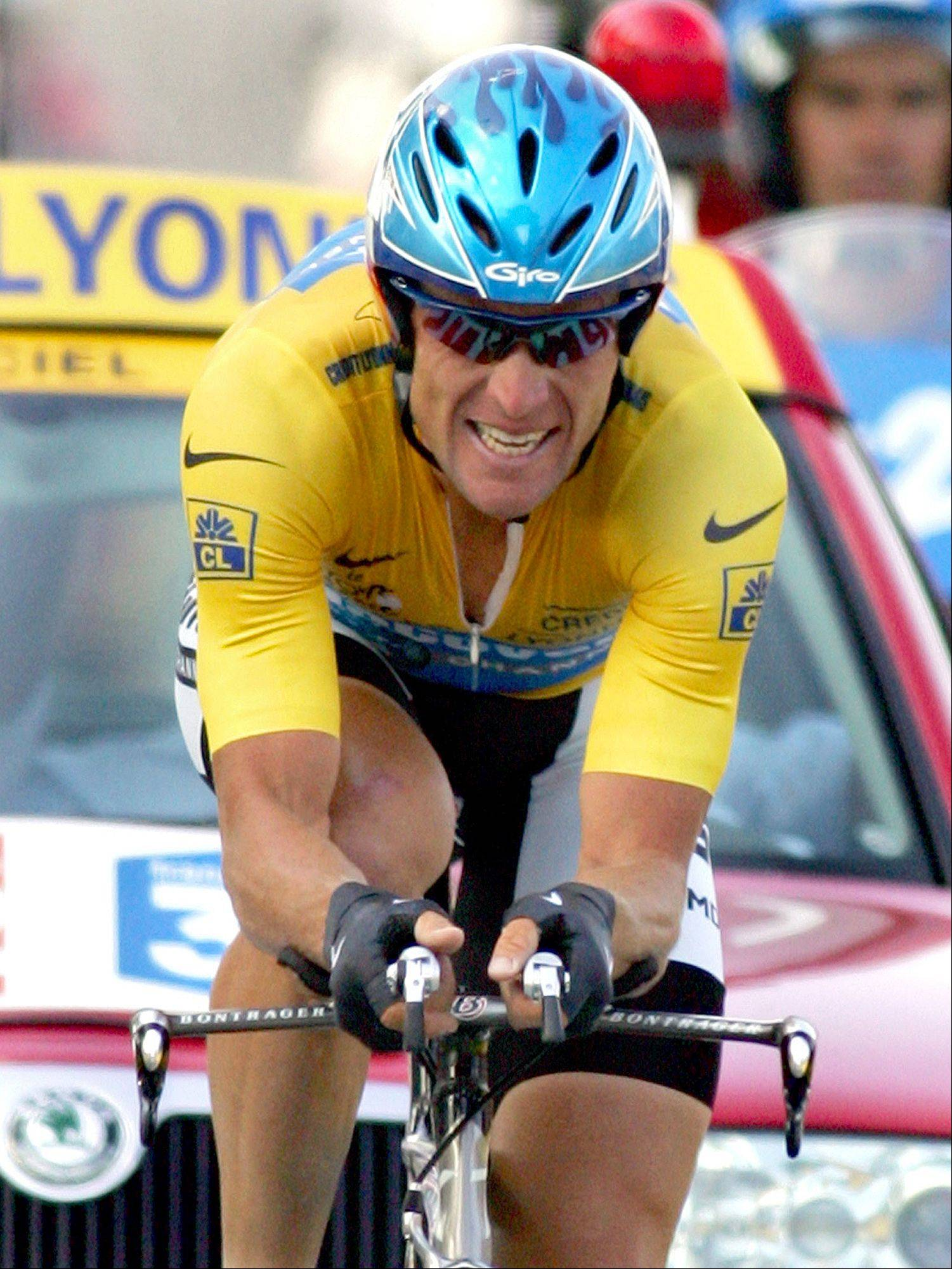 "In this July 23, 2005 file photo, overall leader Lance Armstrong, of Austin, Texas, crosses the finish line to win the 20th stage of the Tour de France cycling race, a 55.5-kilometer (34.5-mile) individual time trial looping around north of Saint-Etienne, central France. Armstrong is getting back on his bike, determined to win an eighth Tour de France. The Tour ""is the intention,"" Armstrong's spokesman Mark Higgins told The Associated Press, ""but we've got some homework to do over there."""