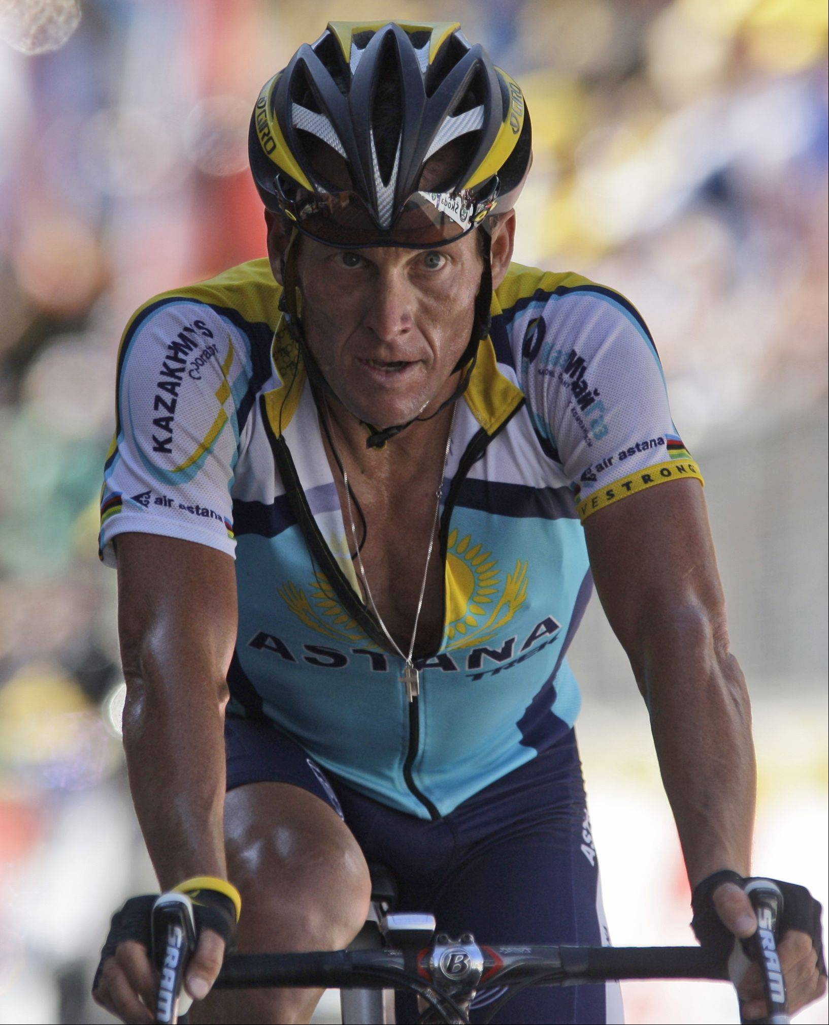 American seven-time Tour de France winner Lance Armstrong crosses the finish line during 15th stage of the Tour de France cycling race over 207.5 kilometers (129 miles) with start in Pontarlier, France and finish in Verbier, Switzerland, Sunday July 19, 2009.