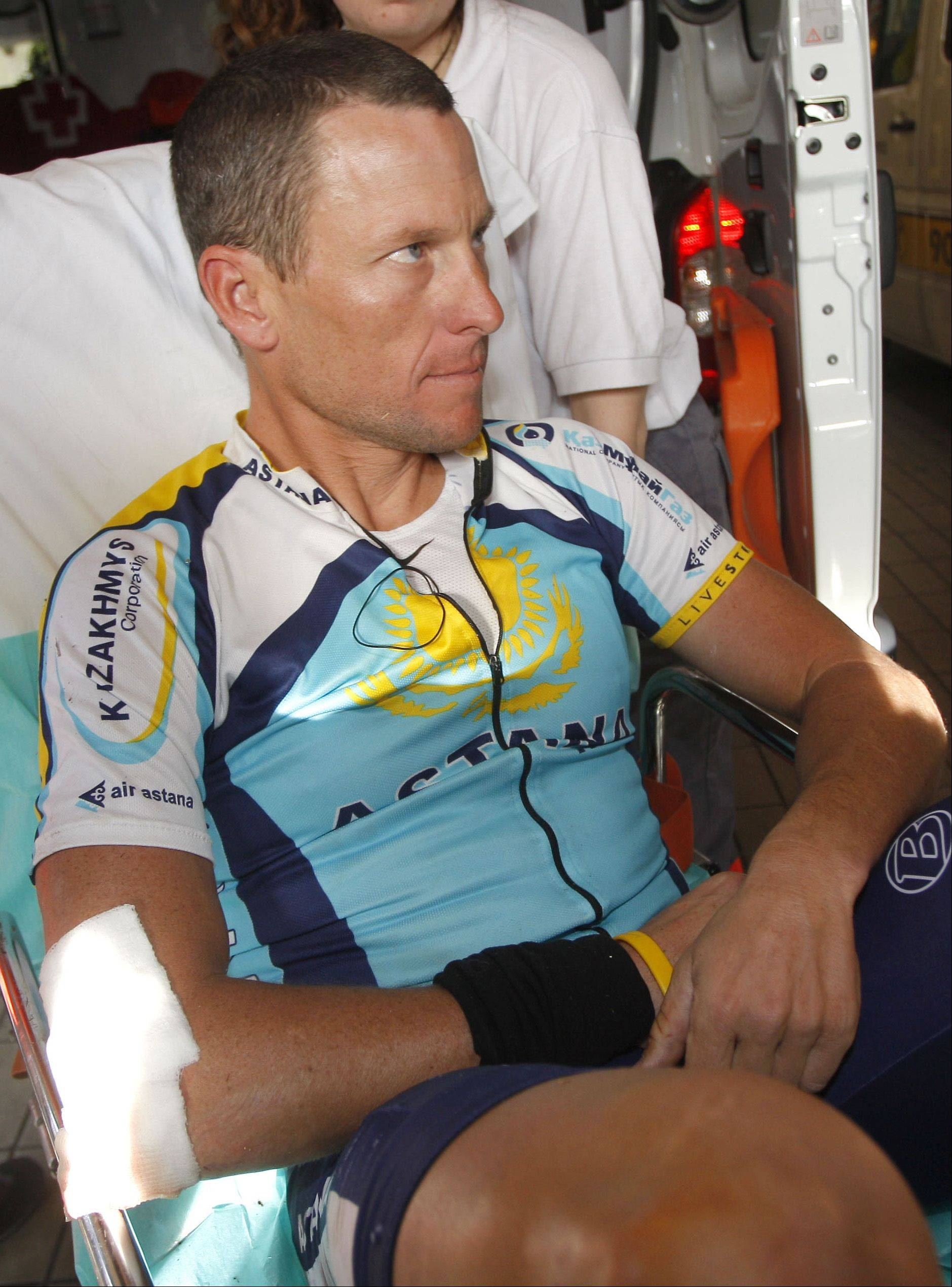 Lance Armstrong of the U.S. is seen in an ambulance as he arrives at Hospital Clinico in Valladolid, Spain, Monday March 23, 2009. Armstrong fractured his collarbone Monday in a crash during the Vuelta of Castilla and Leon race, disrupting the seven-time Tour de France champion's comeback. Armstrong said he would fly to the United States and meet with medical experts to decide whether he needs surgery, leaving in question his participation in the Tour de France in July.